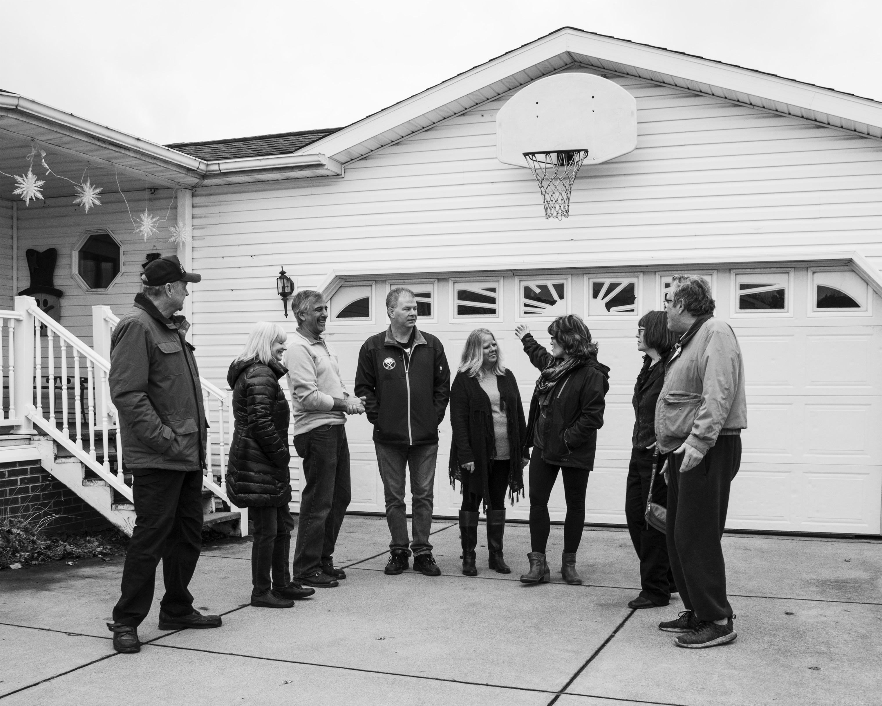 Maribeth Sheedy and her husband Shawn speak with other residents of the Akron Manufactured Home Community