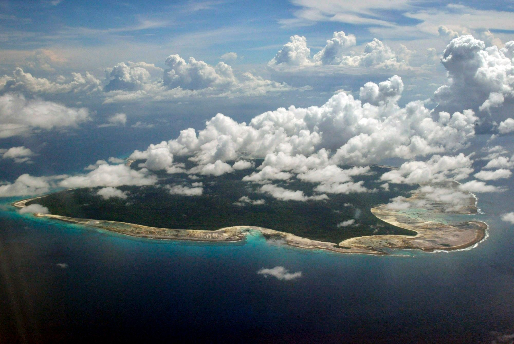 In this undated file photo, clouds hang over the North Sentinel Island, in India's southeastern Andaman and Nicobar Islands.