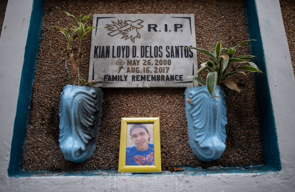 A photograph of Kian delos Santos is seen at his grave at the Lalopma Cemetery in Manila on November 29, 2018.