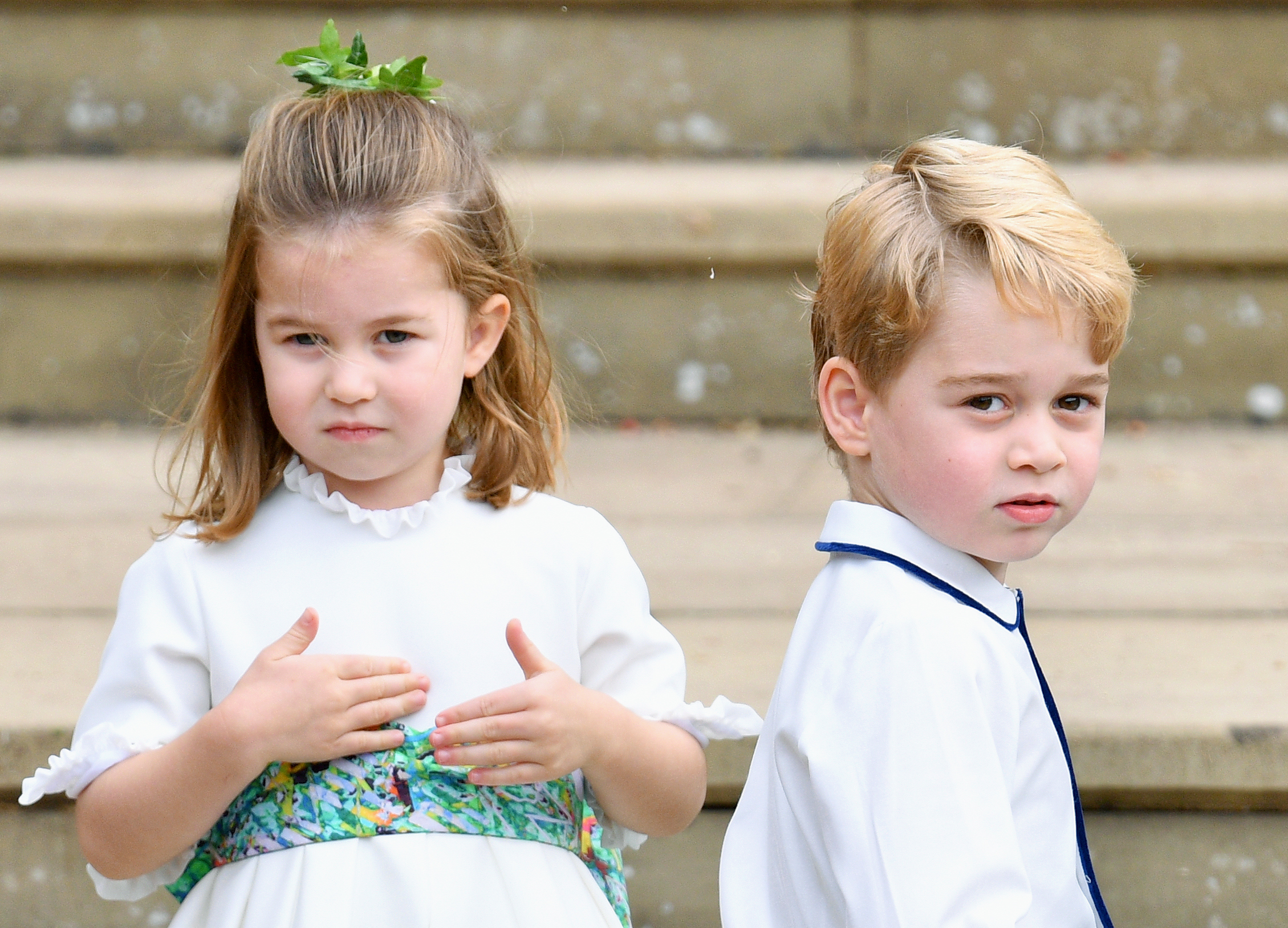 Princess Charlotte of Cambridge and Prince George of Cambridge attend the wedding of Princess Eugenie of York and Jack Brooksbank at St George's Chapel on October 12, 2018 in Windsor, England.