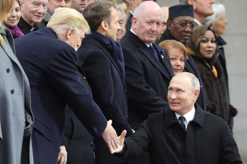 Russian President Vladimir Putin (R) shakes hands with U.S. President Donald Trump as he arrives to attend a ceremony at the Arc de Triomphe in Paris on November 11, 2018 as part of commemorations marking the 100th anniversary of the 11 November 1918 armistice, ending World War I.