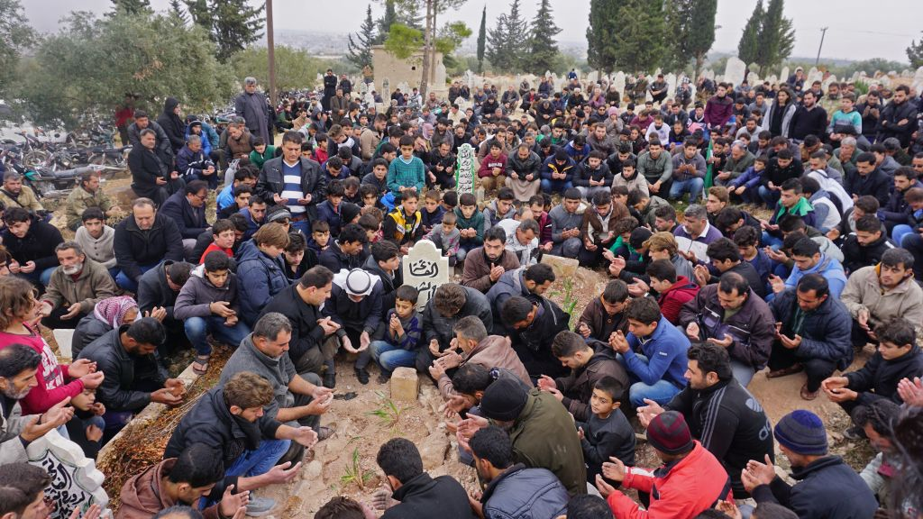 Mourners attend the funeral of Raed Fares and Hammoud al-Jneid in the village of Kafranbel in the northwestern province of Idlib on November 23, 2018.