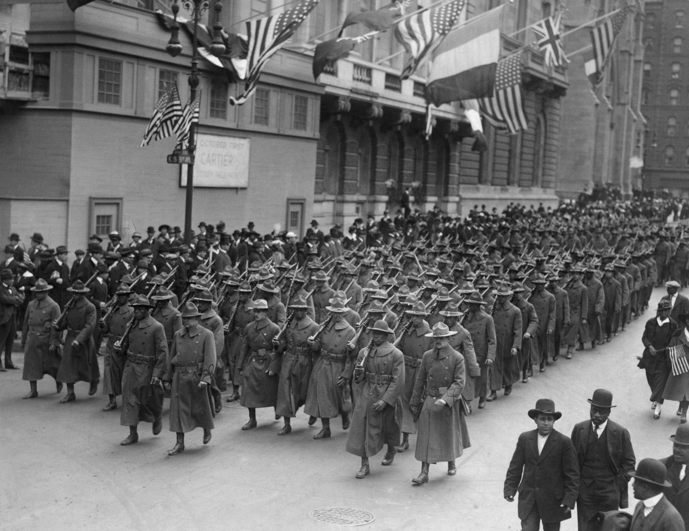 The all black 15th regiment parading up Fifth Avenue, New York City, en route to an Army camp in New York State in 1916.