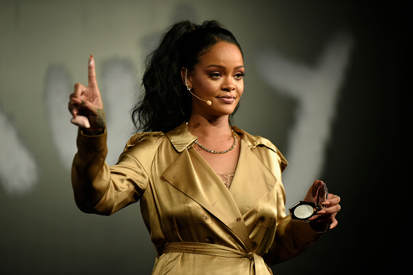 Rihanna gestures on stage during her Fenty Beauty talk in collaboration with Sephora on September 29, 2018 in Dubai, United Arab Emirates.