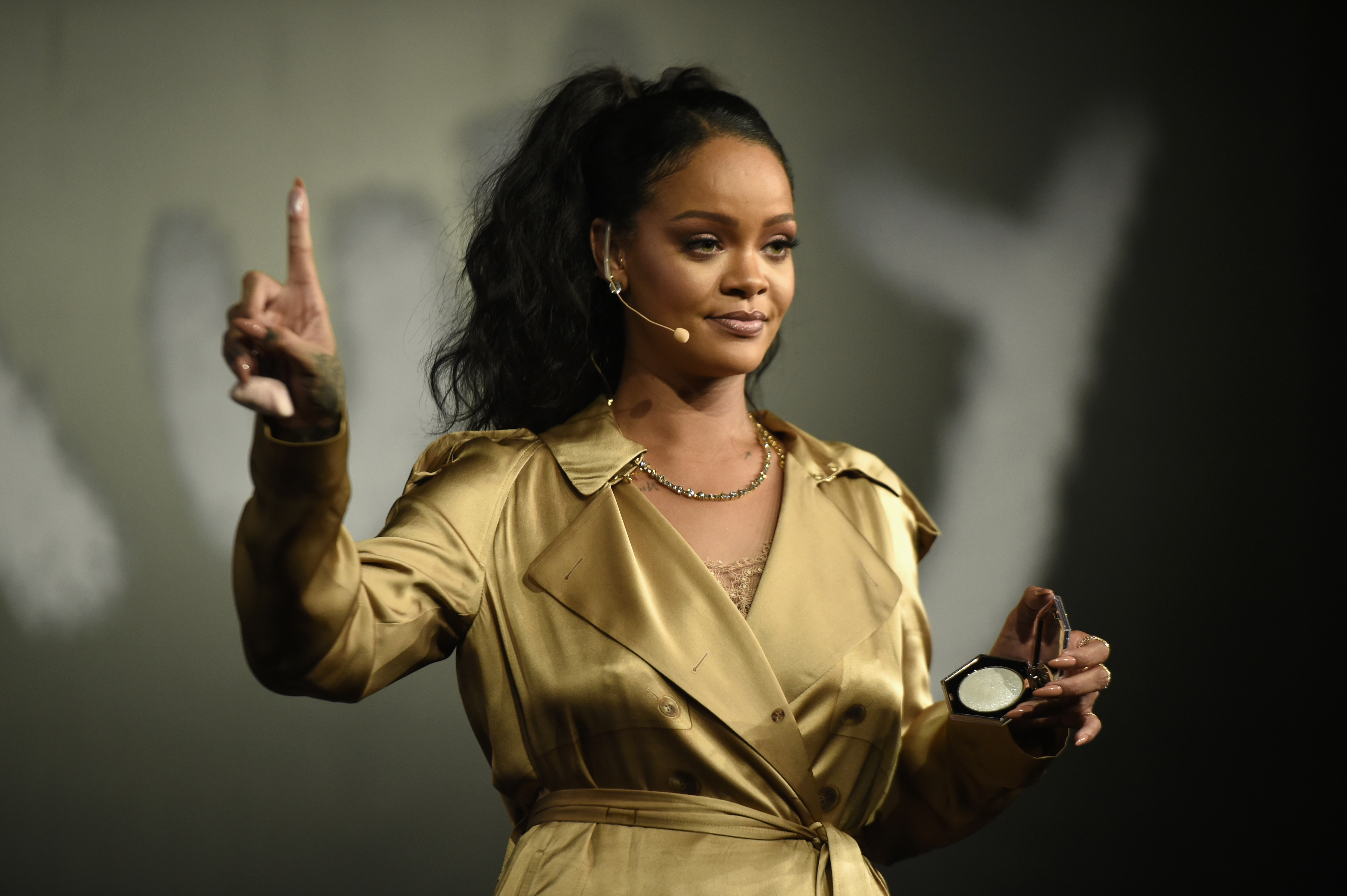 Rihanna gestures on stage during her Fenty Beauty talk in collaboration with Sephora, for the launch of her new Stunna Lip paint  Uninvited  on September 29, 2018 in Dubai, United Arab Emirates.