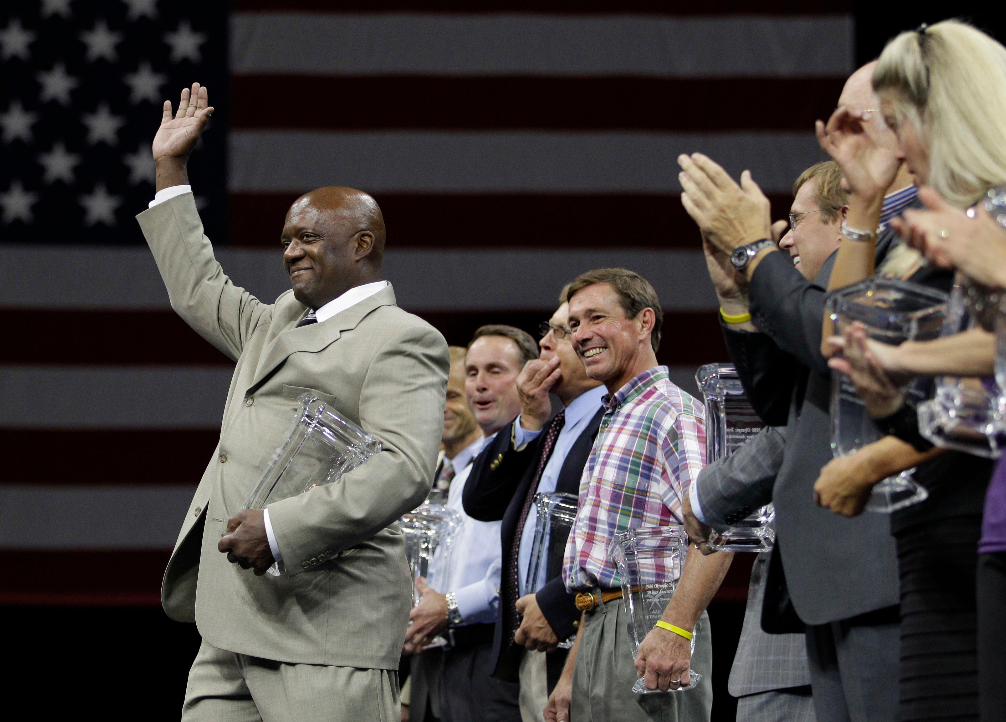 Ron Galimore waves to the crowd as he and others from the 1980 Olympic gymnastics team who did not compete due to the U.S. boycott of the Olympic Games, are honored at the U.S. Gymnastics Championships in Hartford, Conn. on August 14, 2010. On Nov. 16, 2018 it was announced that Galimore resigned from being USA Gymnastics' COO.