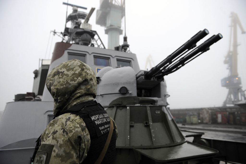 Ukrainian soldier patrols aboard military boat called  Dondass  moored in Mariupol, Sea of Azov port on November 27, 2018.