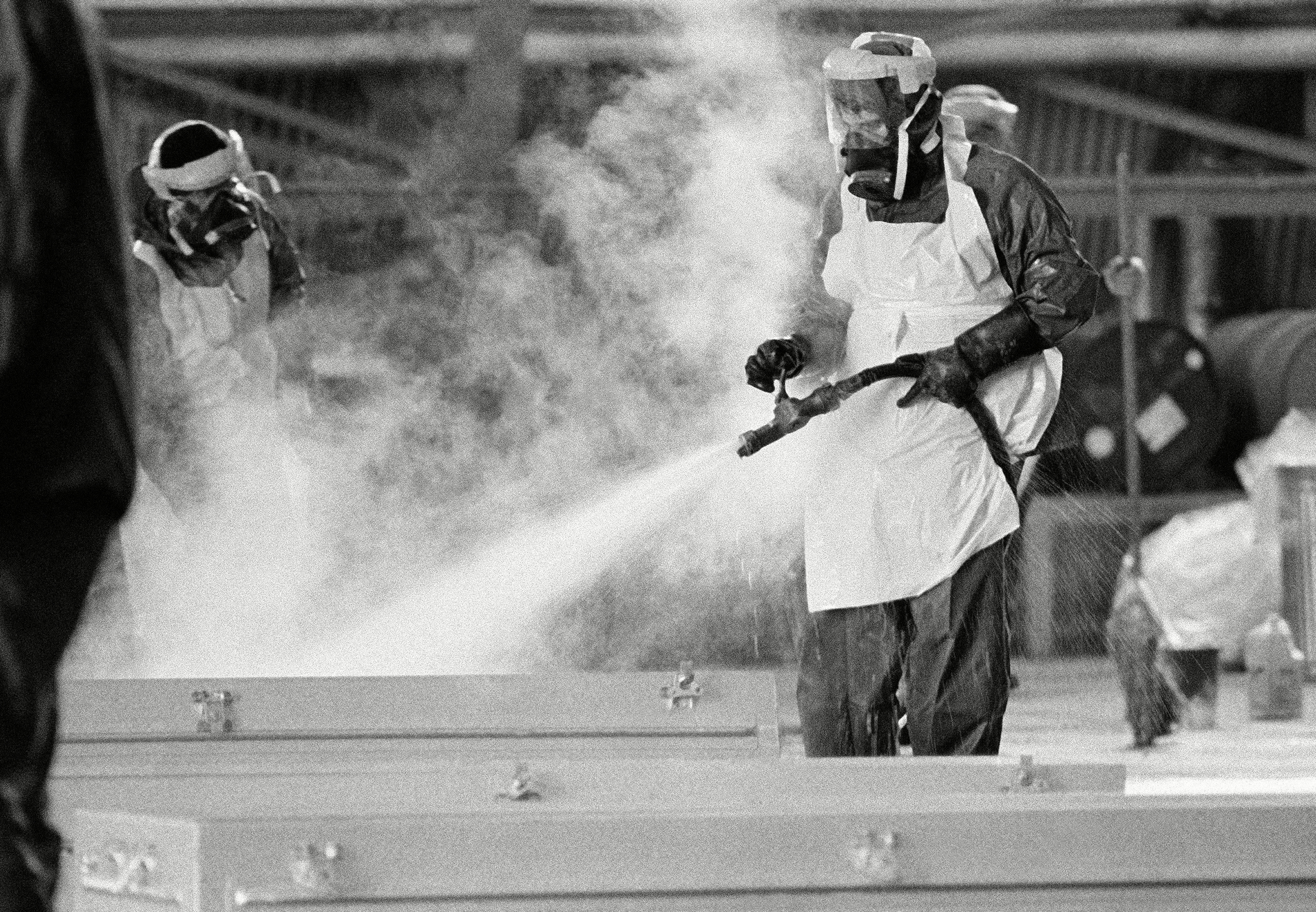 With more bodies being found at the Jonestown mass suicide scene in Guyana, the military is being asked to ship more caskets to bring the bodies back to the U.S. Here a volunteer airman uses steam mixed with chemicals to clean and disinfect a metal casket at Dover Air Force Base in Delaware, for reuse again in Guyana.