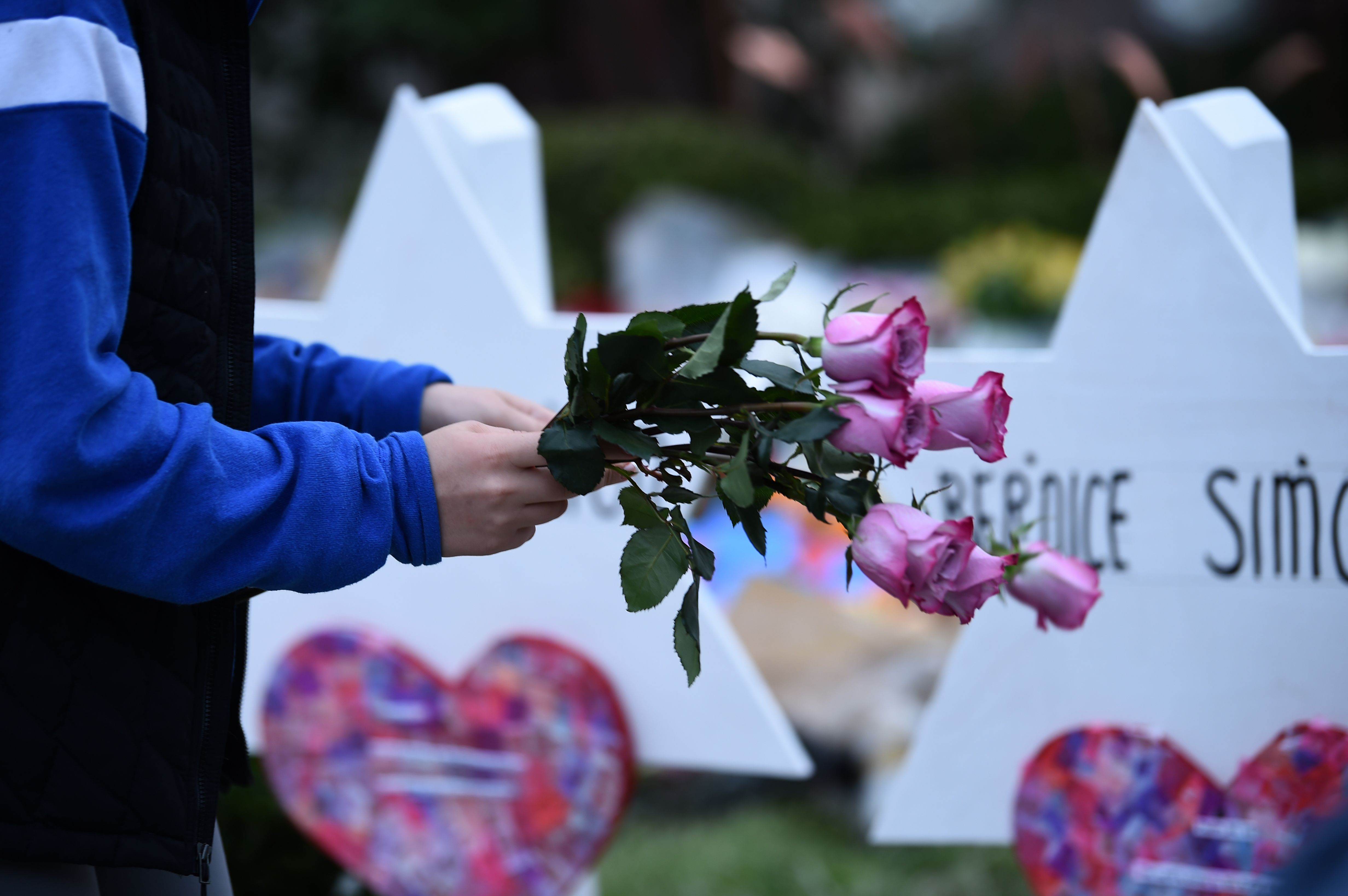 People pay their respects at a memorial outside the Tree of Life synagogue after a shooting there left 11 people dead in the Squirrel Hill neighborhood of Pittsburgh, Pennsylvania on October 29, 2018. Bernice and Sylvan Simon, married 62 years, were laid to rest Thursday.