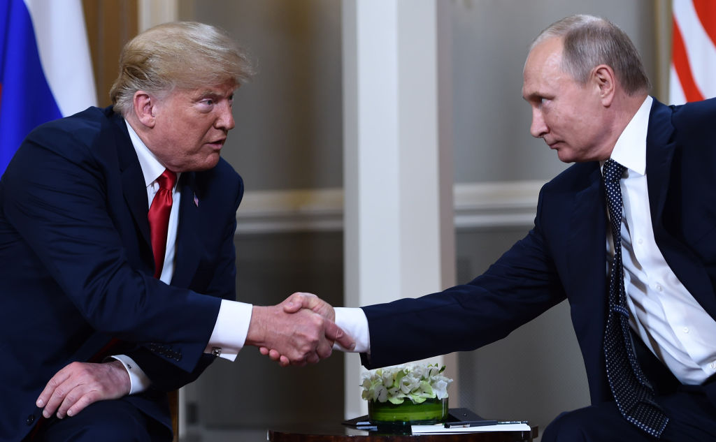 Russian President Vladimir Putin and US President Donald Trump shake hands before a meeting in Helsinki, on July 16, 2018. On Nov. 29, 2018, Trump tweeted that he is canceling his meeting with Putin at the G-20 due to Russian ships the Kerch Strait near Crimea.