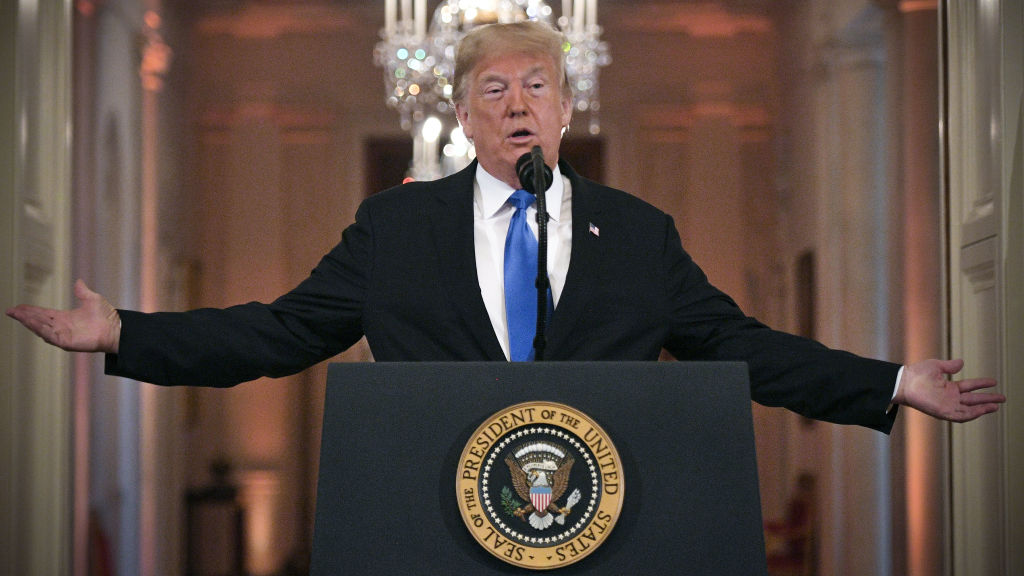 US President Donald Trump speaks during a post-election press conference in the East Room of the White House in Washington, DC on November 7, 2018. He warns House Democrats about investigating him and his administration now that they control the House.
