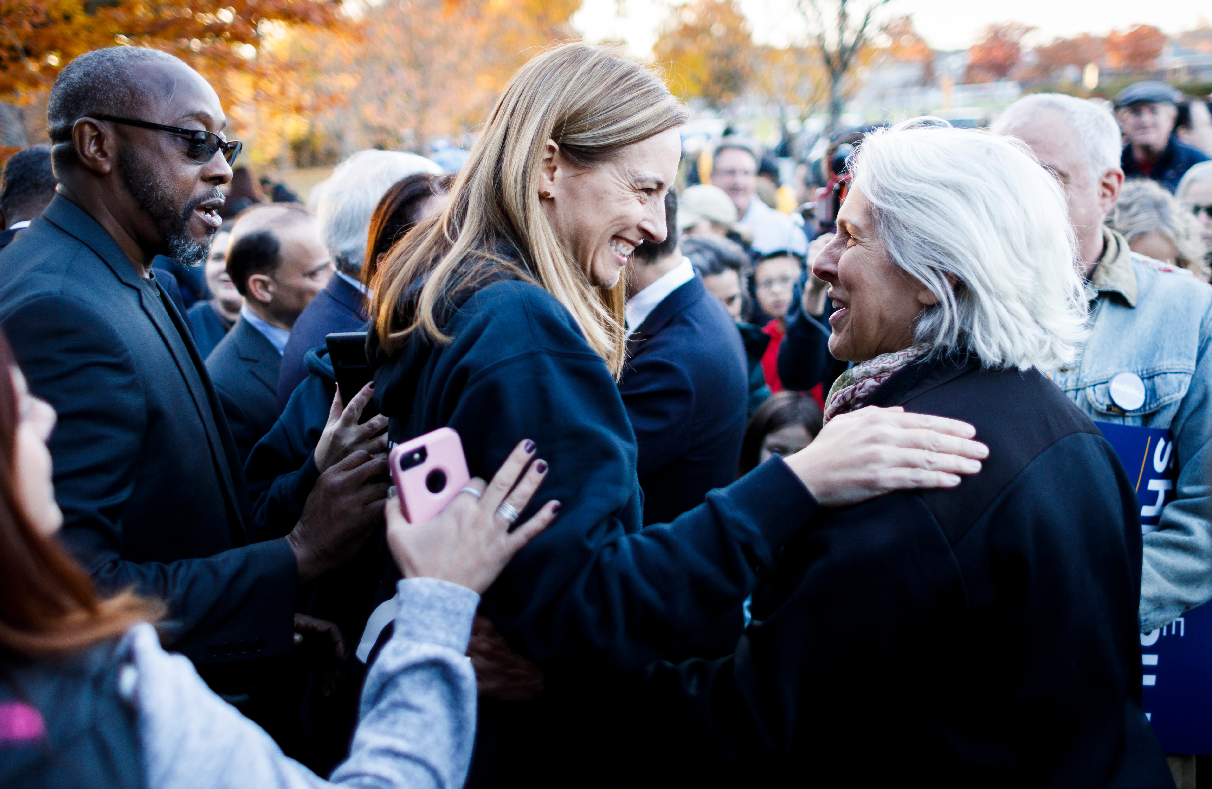 Democratic congressional candidate Mikie Sherrill, who is running to represent New Jersey's 11th district, talks with supporters during a get-out-the-vote rally in Livingston, New Jersey, on Nov. 4, 2018. Sherrill is a Naval Academy graduate and a former Navy helicopter pilot.