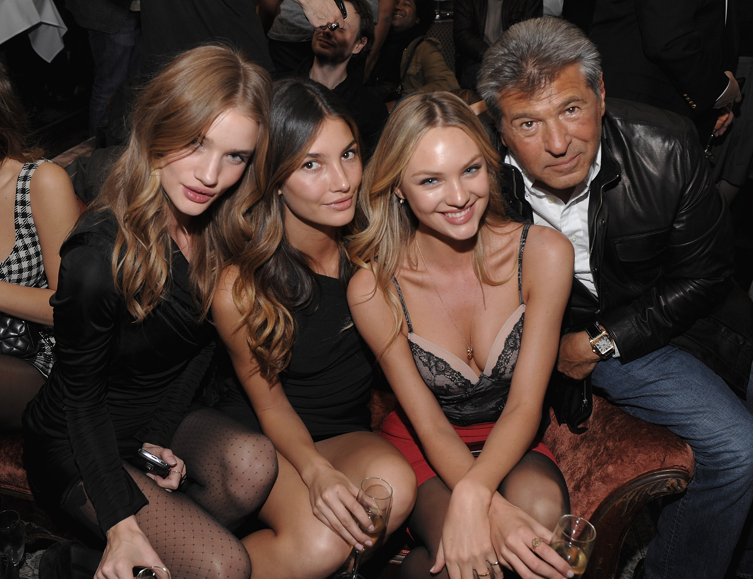Chief marketing officer Razek poses with models Rosie Huntington-Whiteley, Lily Aldridge and Candice Swanepoel in 2009