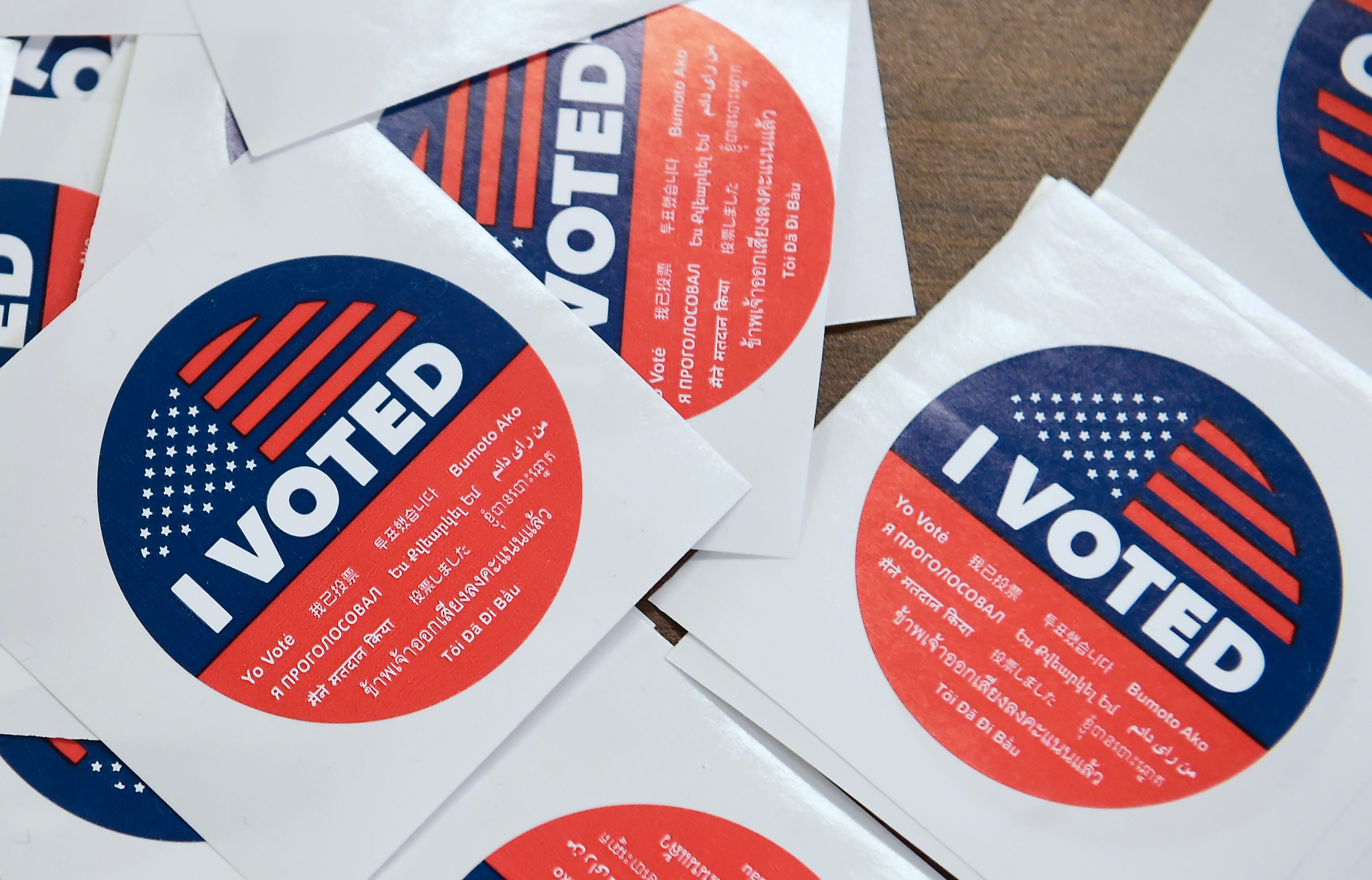 California's multi-language  I Voted  stickers on offer for early voters at the Los Angeles County Registrar's Office in Norwalk, California on November 5, 2018, a day ahead the November 6 midterm elections in the United States. (Photo by Frederic J. BROWN / AFP)        (Photo credit should read FREDERIC J. BROWN/AFP/Getty Images)