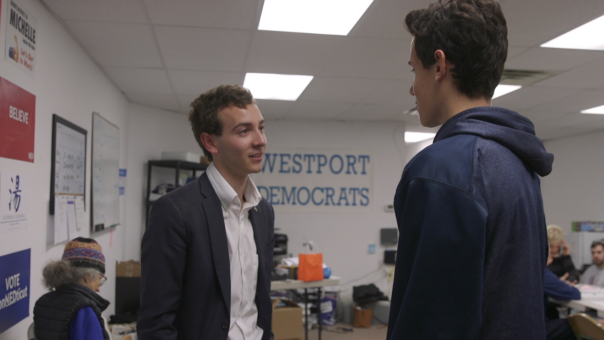 22-year-old Connnecticut state Senate candidate Will Haskell speaks with a campaign volunteer during a phone bank in Westport, CT on Oct. 30, 2018.