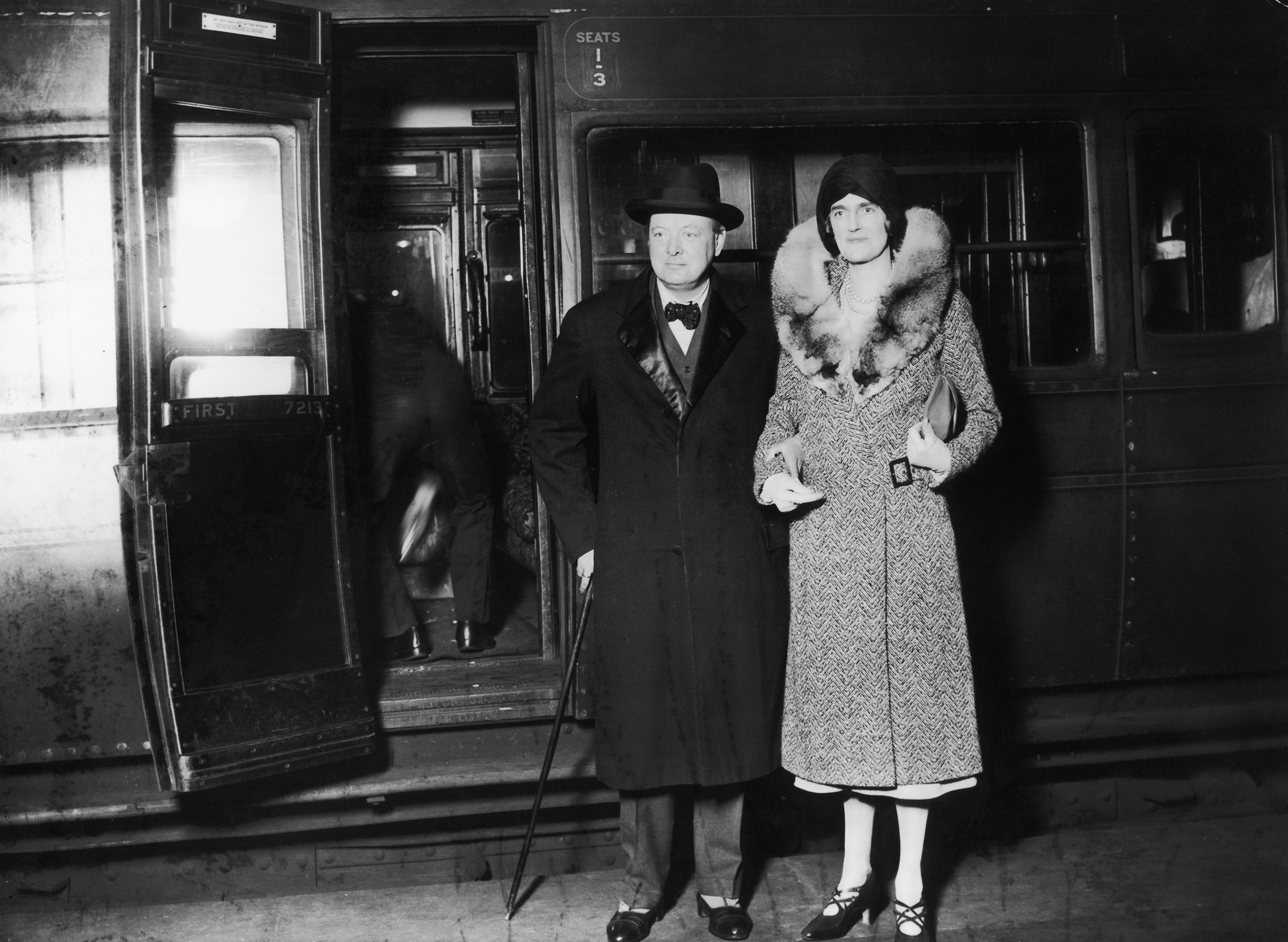 British statesman Winston Churchill and his wife Clementine arrive at Waterloo Station in London, after a visit to the United States, in Nov. 1929.