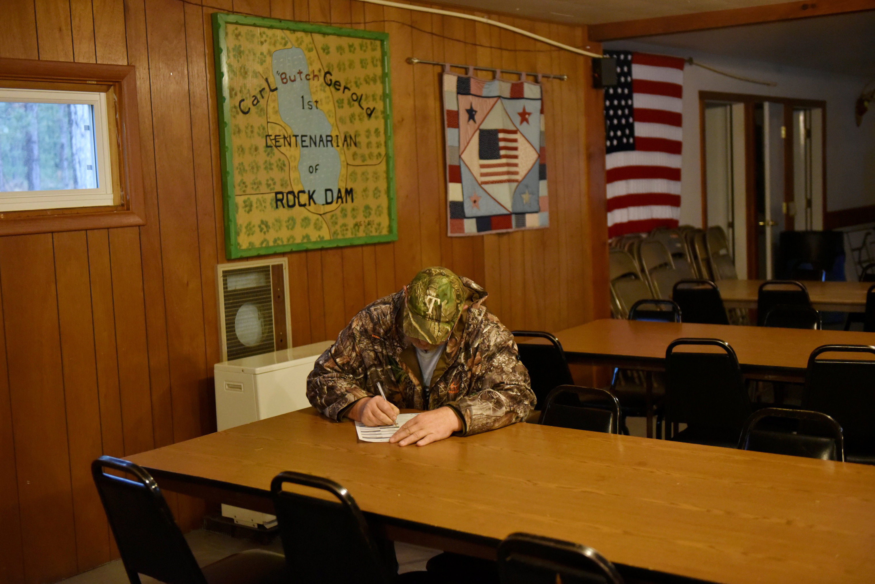 Ivan Ruzic fills out his ballot for the midterm election at the Rock Dam Rod and Gun Club in Foster Township, Wis.