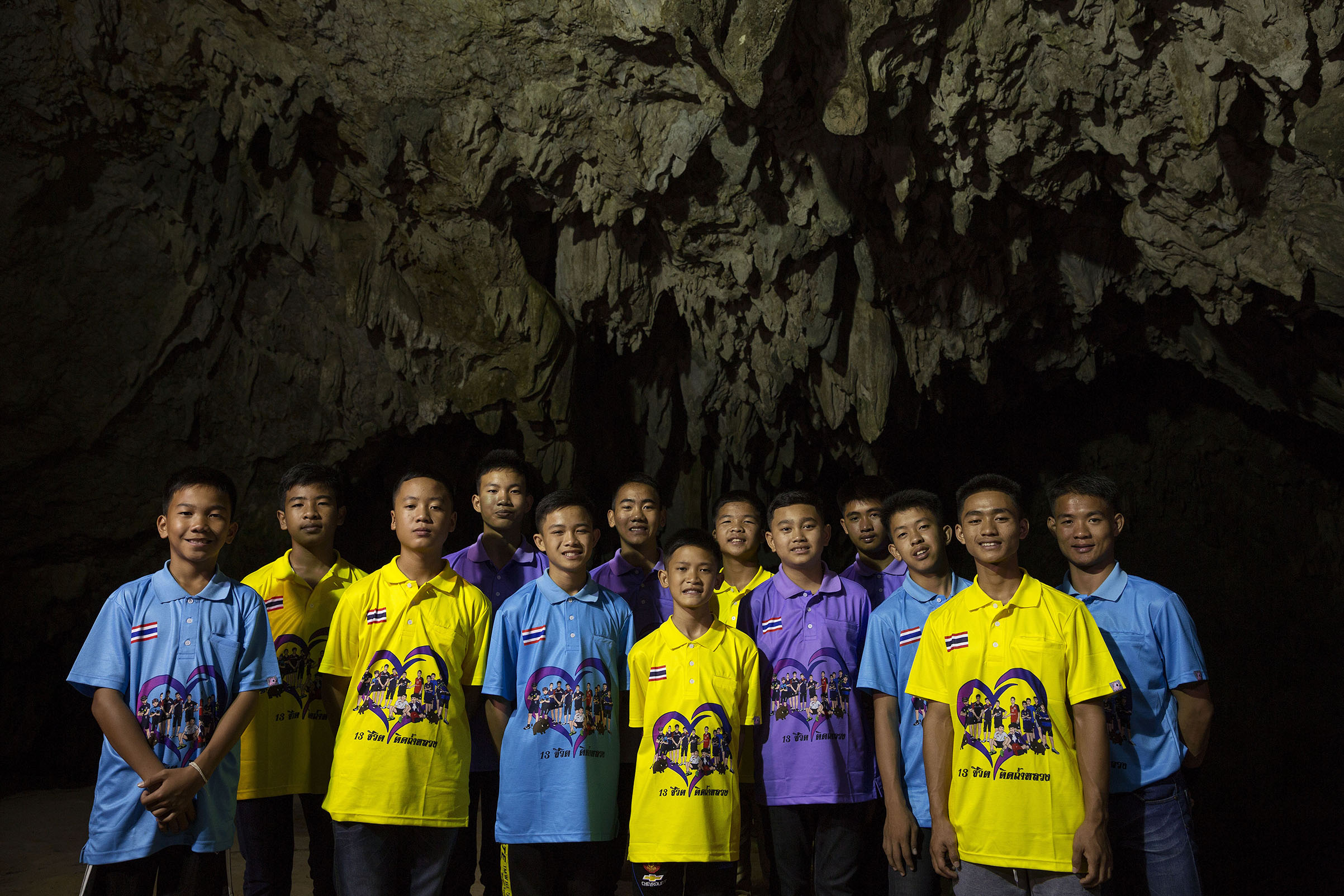 Nearly six months after the rescue, the team poses at the entrance to Tham Luang Cave
