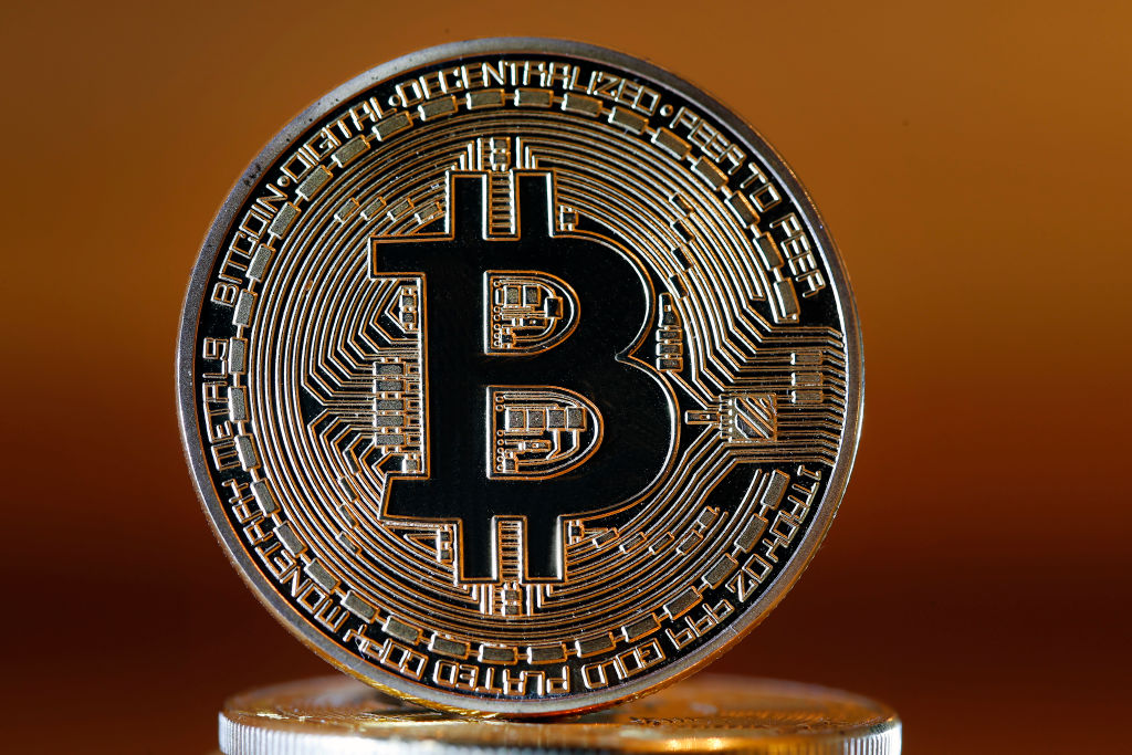 In this photo illustration, a visual representation of the digital Cryptocurrency, Bitcoin is displayed on November 20, 2018 in Paris, France.
