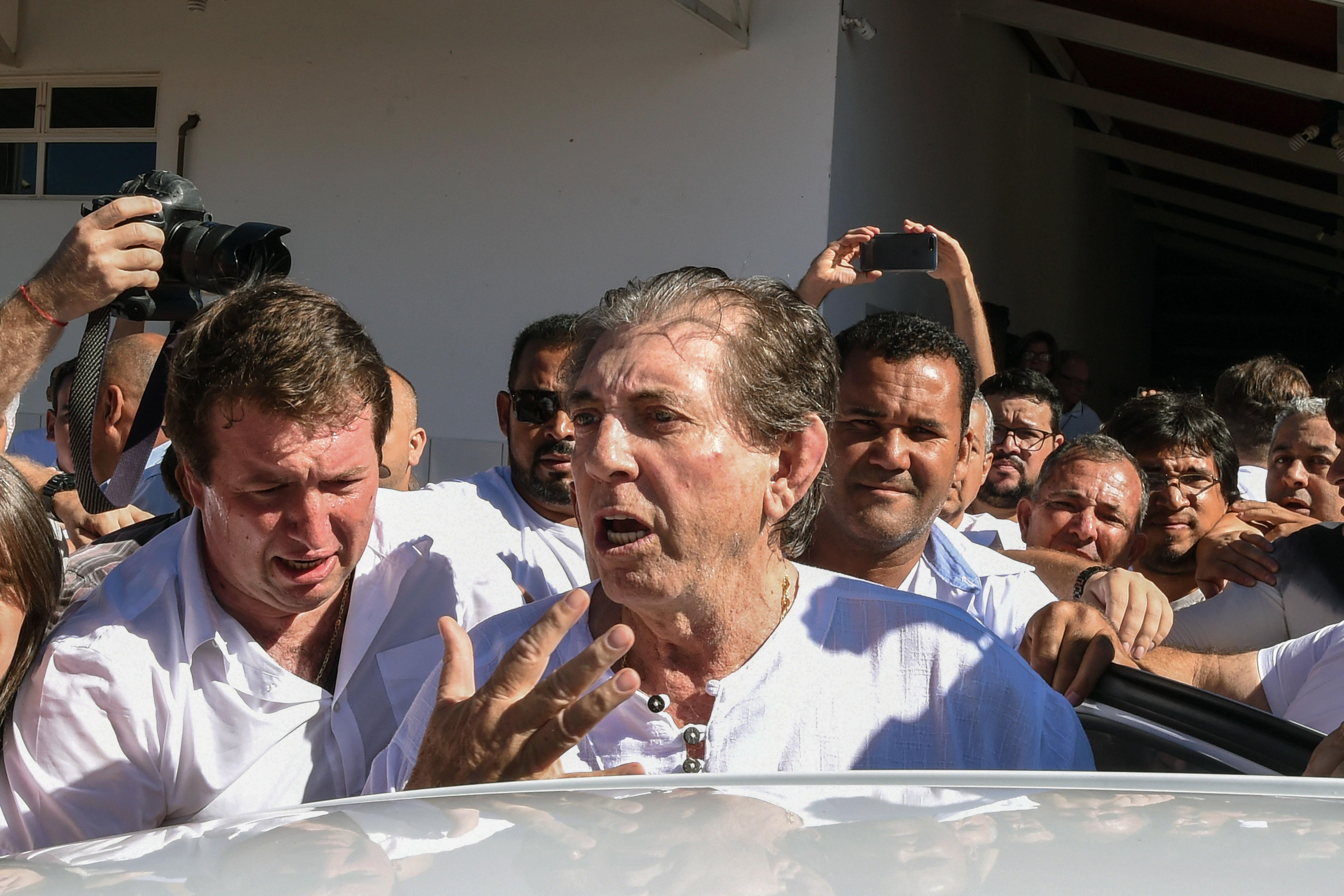 Brazilian  spiritual healer  Joao Teixeira de Faria is escorted by supporters, upon arrival at his  healing center  Casa de Dom Inacio de Loyola, in Abadiania on Dec. 12, 2018.