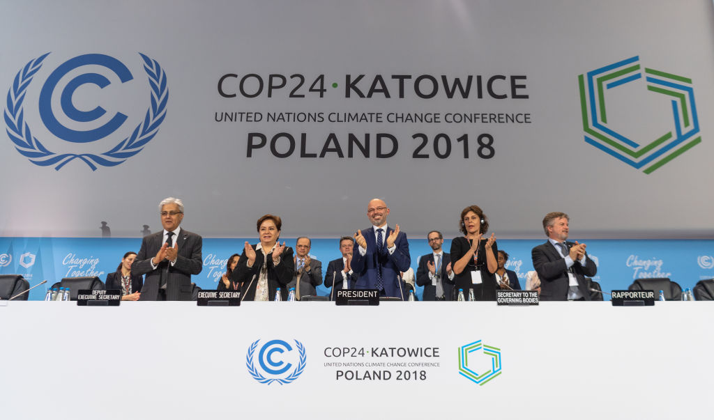 15 December 2018, Poland, Katowice: Michal Kurtyka (M), President of the UN Climate Change Conference COP24, and other participants of the climate summit are pleased about the decision of the compromise at the world climate summit.