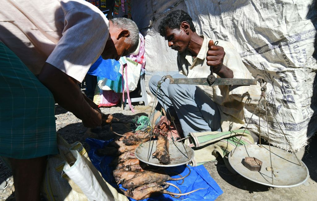 An Indian Tea-tribe vendor sells cooked rats at a weekly market in Kumarikata village along the Indo-Bhutan border, on Dec. 23, 2018.