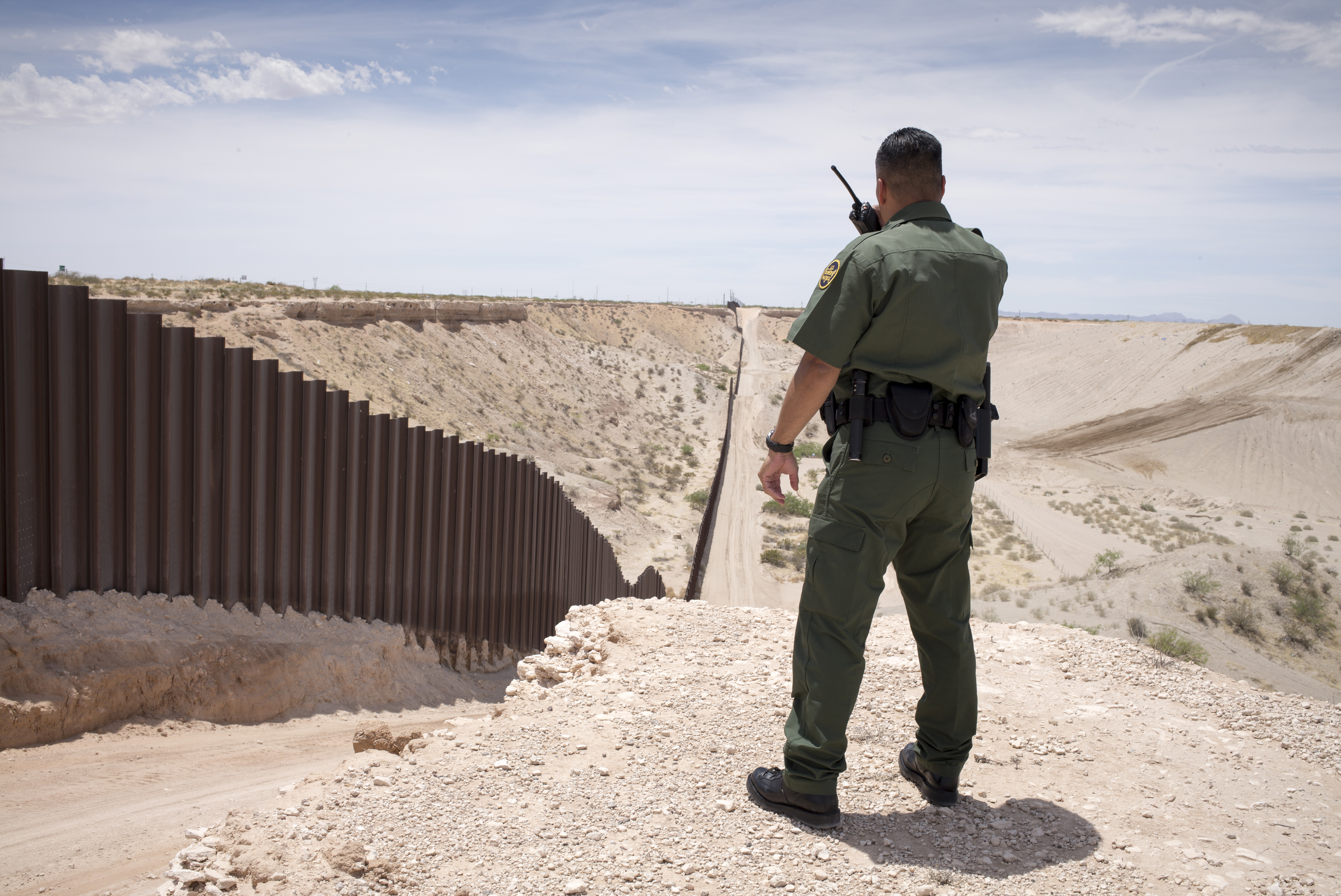 A Border Patrol agent watches over the border fence on the U.S.-Mexico border near Sunland Park, New Mexico.