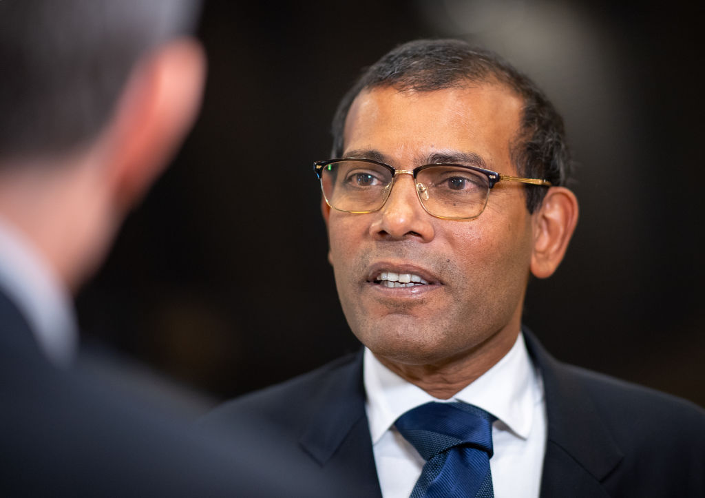 Mohamed Nasheed, former president of the Maldives, talks to journalists after a press conference at the World Climate Summit.