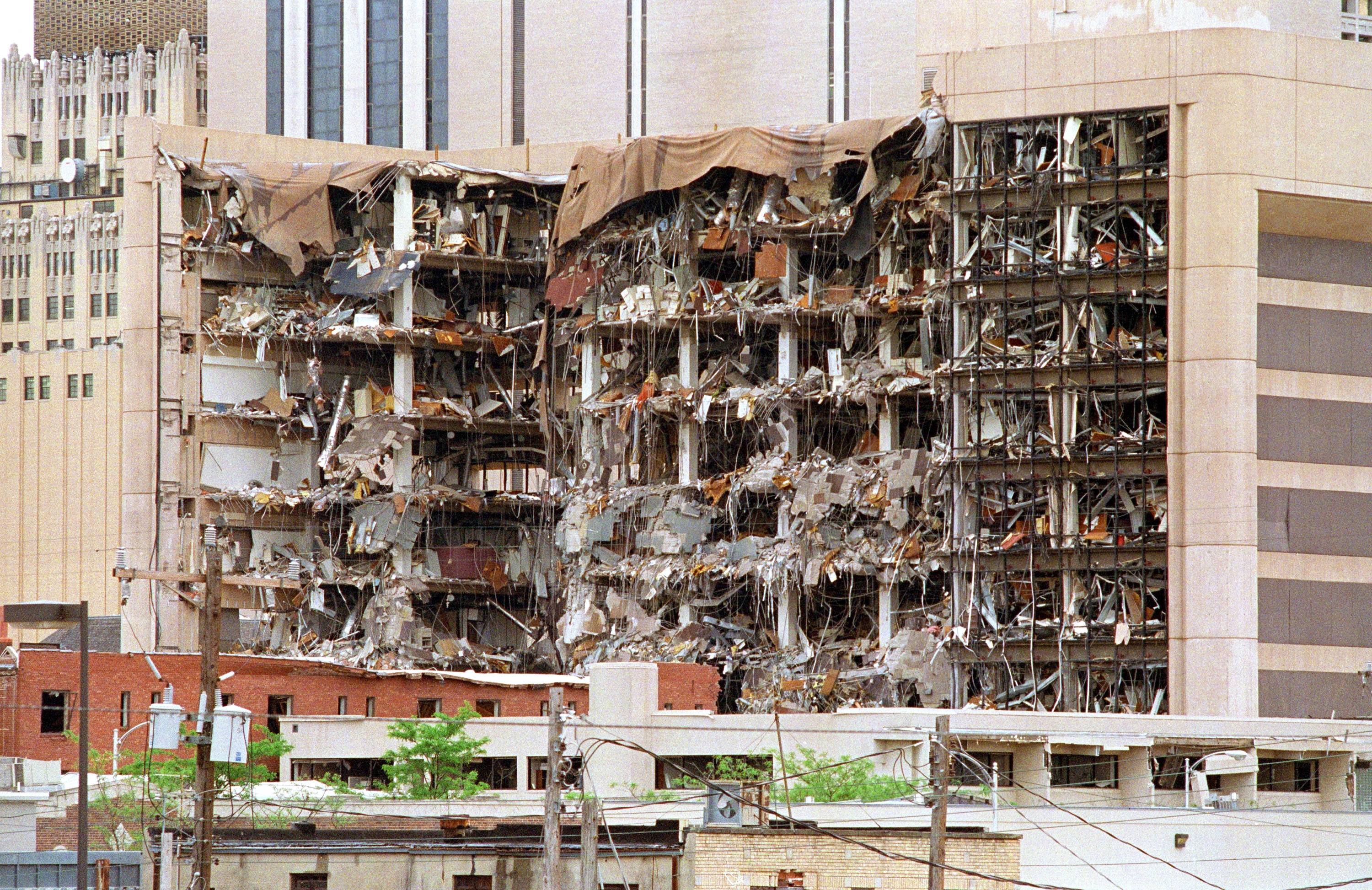 The north side of the Albert P. Murrah Federal Building in Oklahoma City shows 19 April 1995 the devastation caused by a fuel-and fertilizer truck bomb that was detonated early 19 April in front of the building. The blast, the worst terror attack on US soil, killed 168 people and injured more than 500. Timothy McVeigh, convicted on first-degree murder charges for the 19 April bombing was sentenced to death in 1997.
