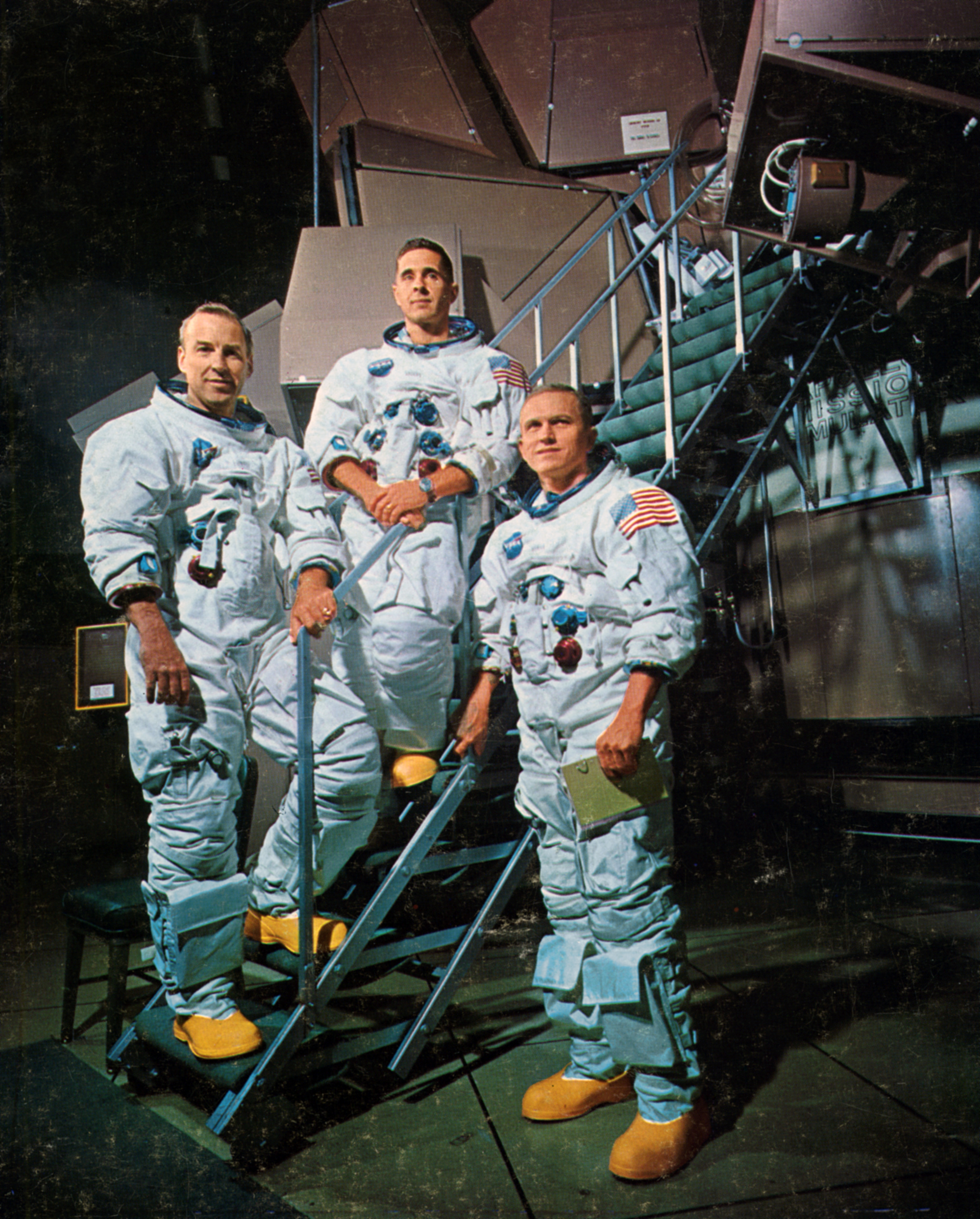 The crew of Apollo 8 in front of a simulator, 1968. From left to right: James A. Lovell, Jr (Command Module pilot); William A. Anders (Lunar Module pilot) and Frank F. Borman, II (mission commander).