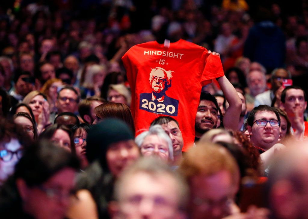 A supporter of US Senator and former Presidential candidate Bernie Sanders holds up a shirt  during his speech at  The People's Summit  in Chicago, June 10, 2017.