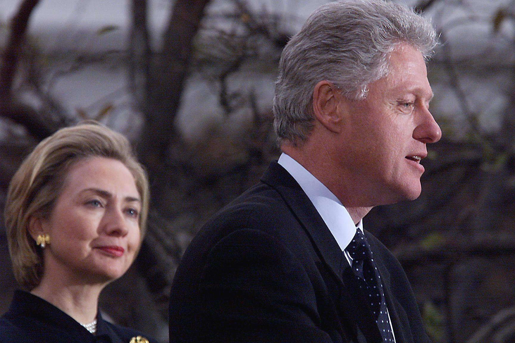 President Bill Clinton (R) appears with First Lady Hillary Clinton to make a statement to reporters outside the oval office following his impeachment by the U.S. House of Representatives.