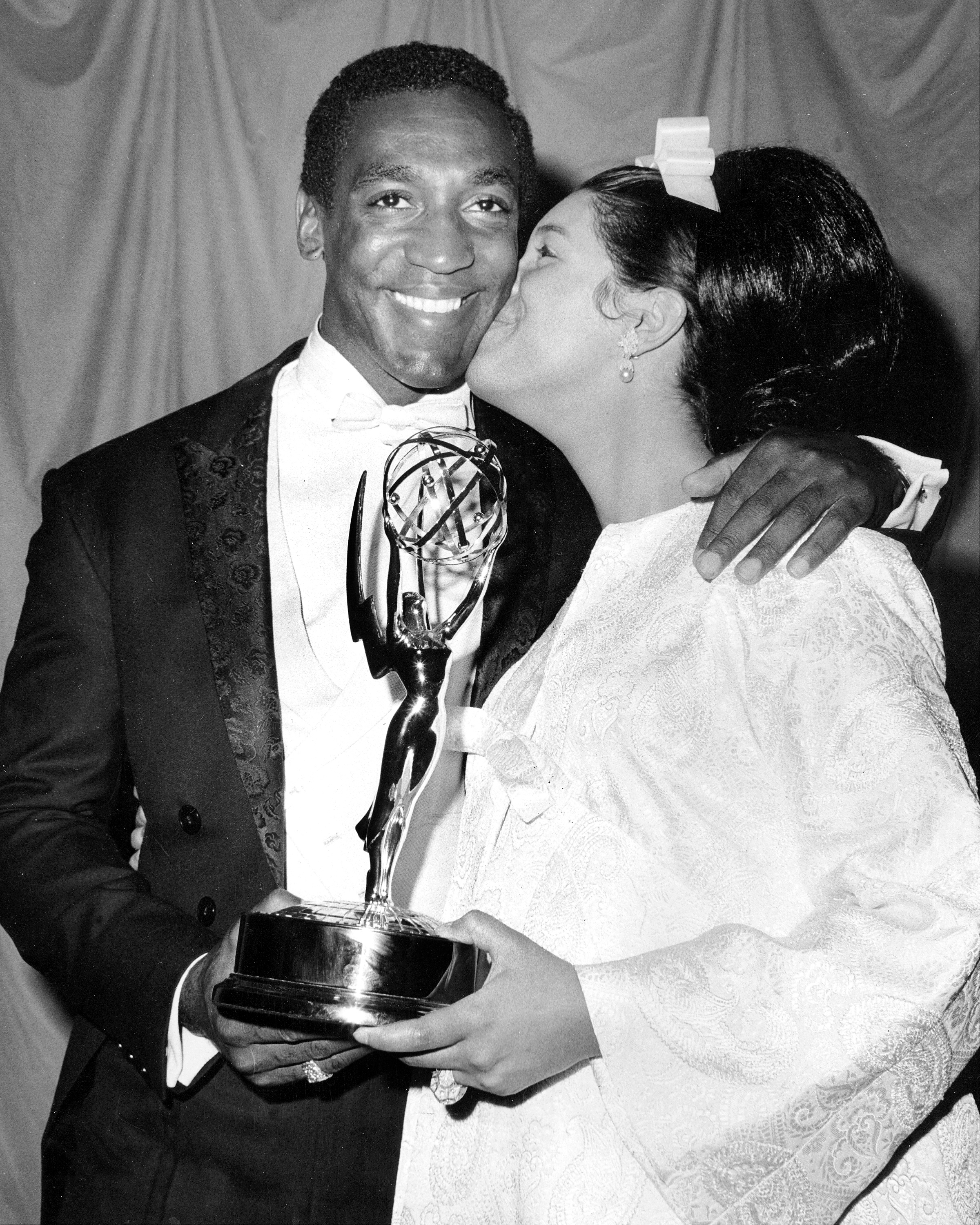 Winner of his first Emmy for  I Spy  is Bill Cosby, here being congratulated by his wife Camille at the Americana Hotel.