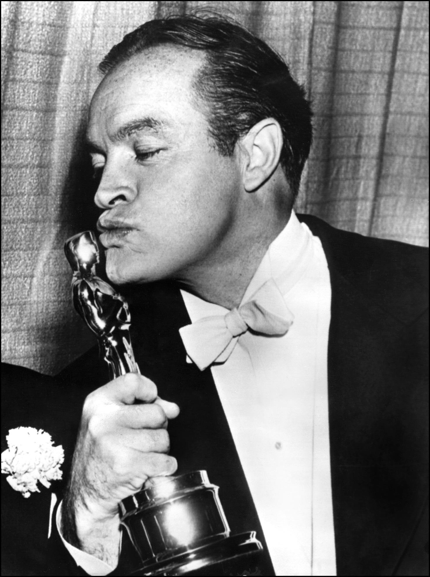 US entertainer Bob Hope shown in photo dated 20 March 1953 kissing the Oscar he received for Special Honors at the Academy Awards show in Hollywood.