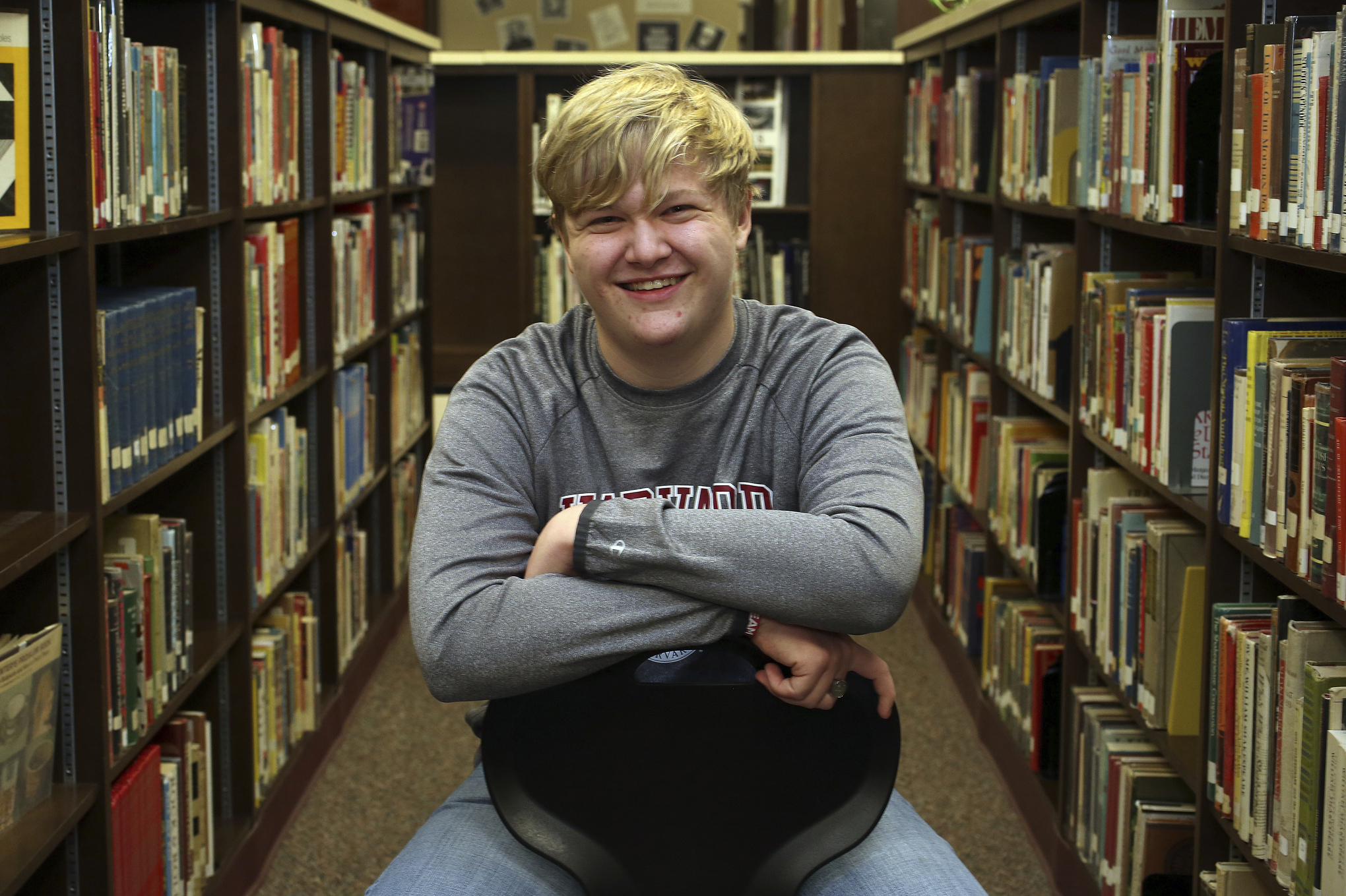 Ulysses High School senior Braxton Moral sits for a portrait at the school in Ulysses, Kan., on Wednesday, Dec. 12, 2018. The 16-year old is set to graduate from Harvard and high school in May 2019.