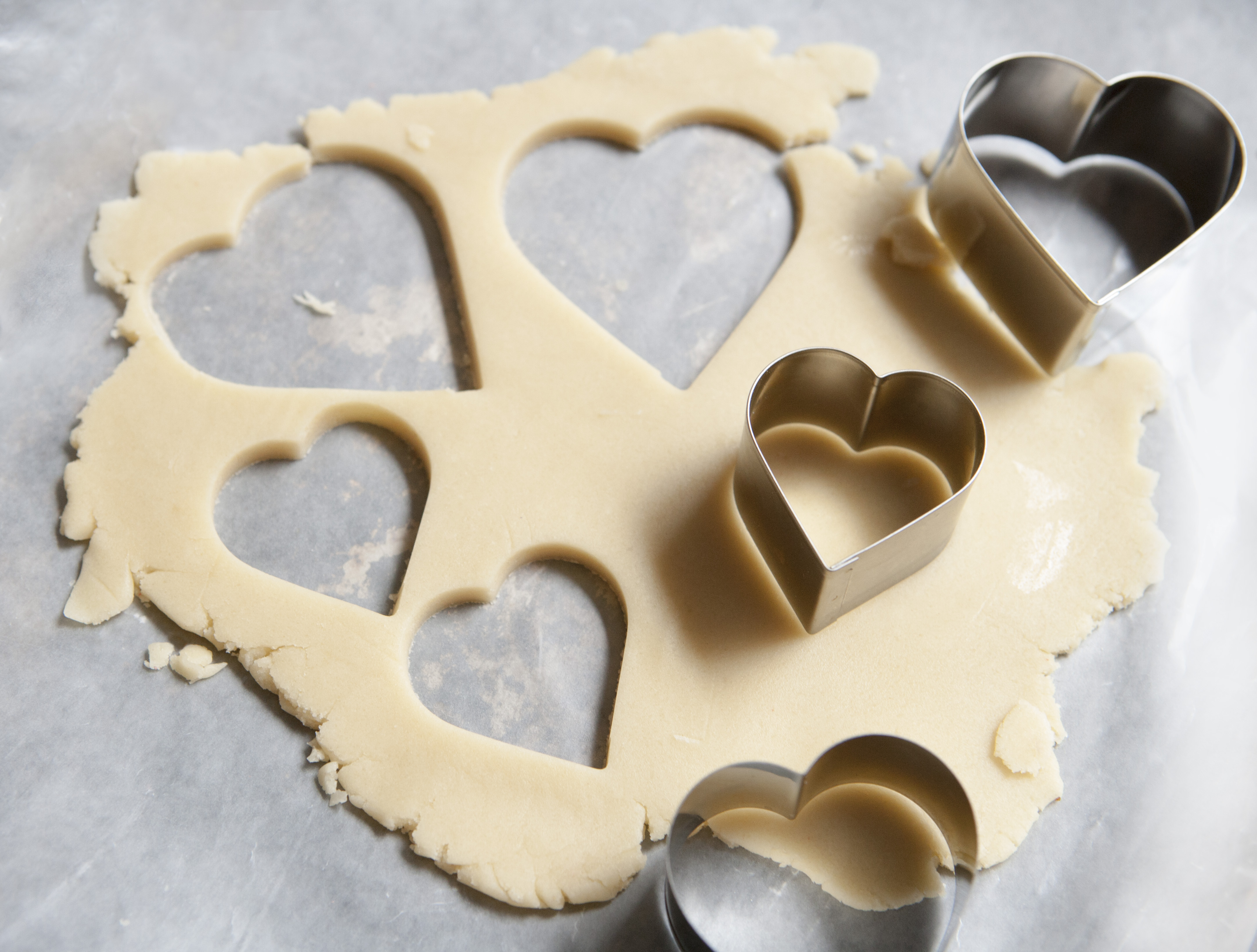 Heart-Shaped Cookie Cutters and Cookie Dough on Wax Paper. (Photo by: Education Images/UIG via Getty Images)