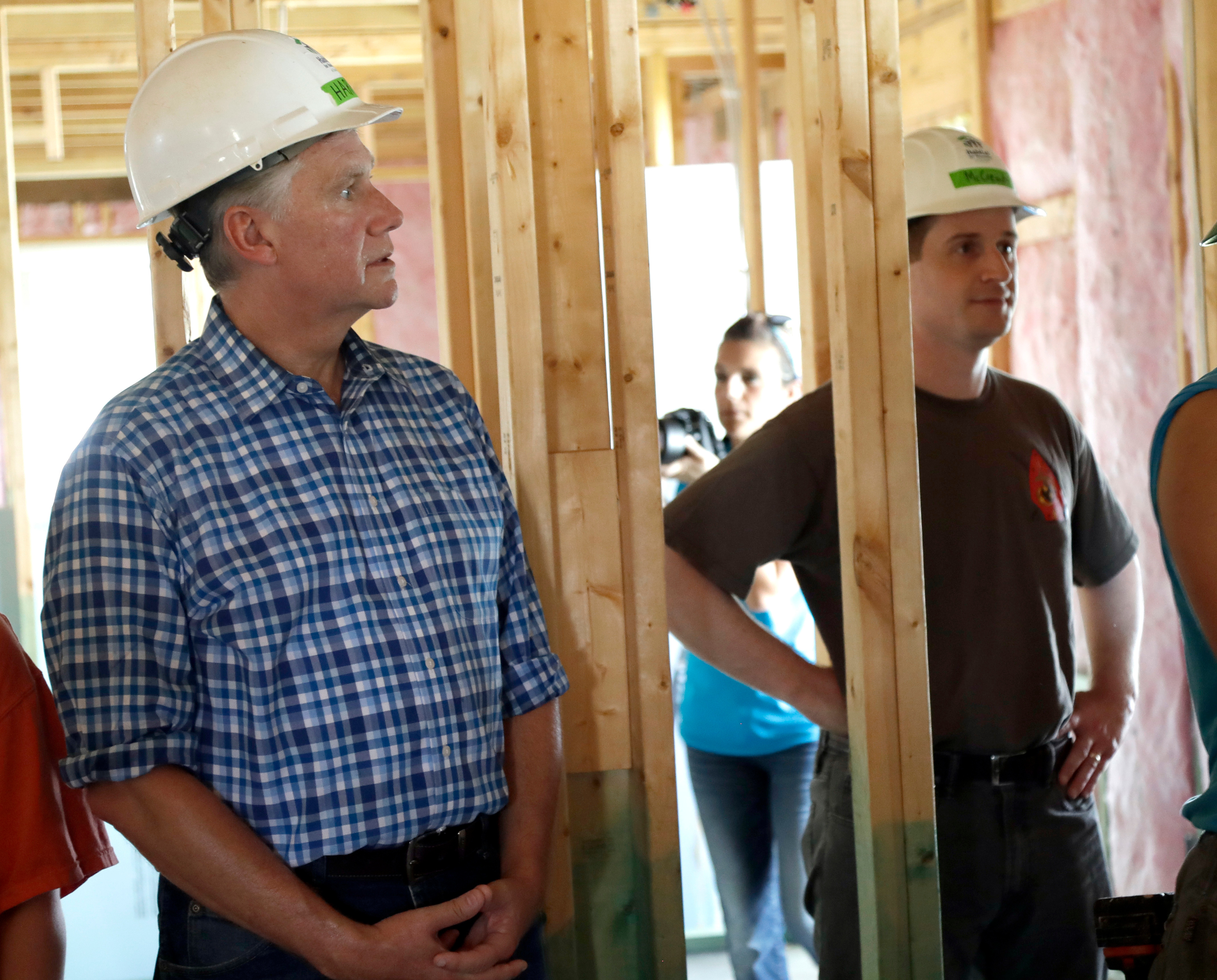 Republican Mark Harris, left, and democrat Dan McCready, right, listen to instructions during a Habitat For Humanity building event in Charlotte, N.C. Harris and McCready are running against each other for the 9th Congressional District                     Election which is still undecided as of Dec. 5, 2018.
