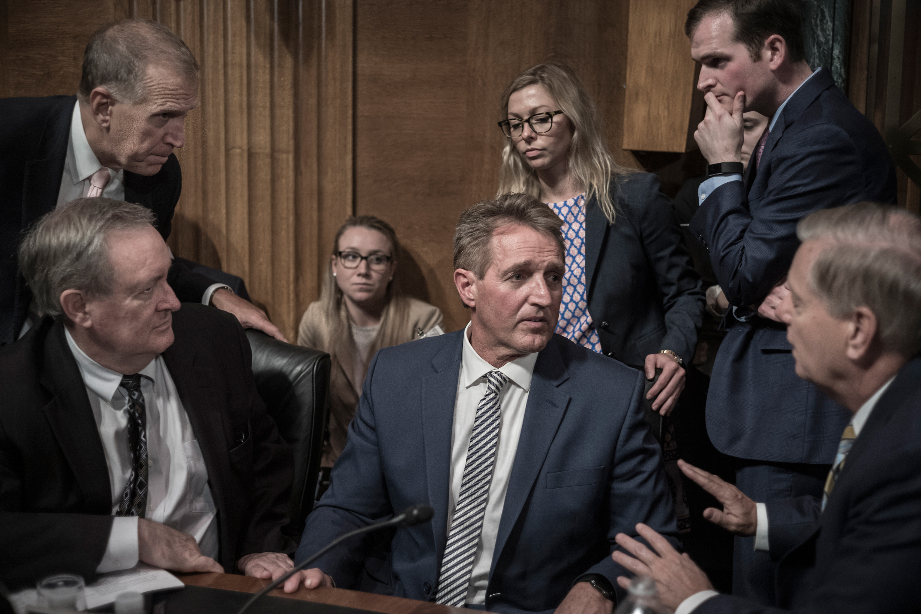Jeff Flake, center, listens to fellow GOP Senator Lindsey Graham, right, on Sept. 28, moments after Flake called for a delay in Brett Kavanaugh's Supreme Court confirmation. His change of heart proved brief; eight days later he joined a slim majority to elevate Kavanaugh to the bench.