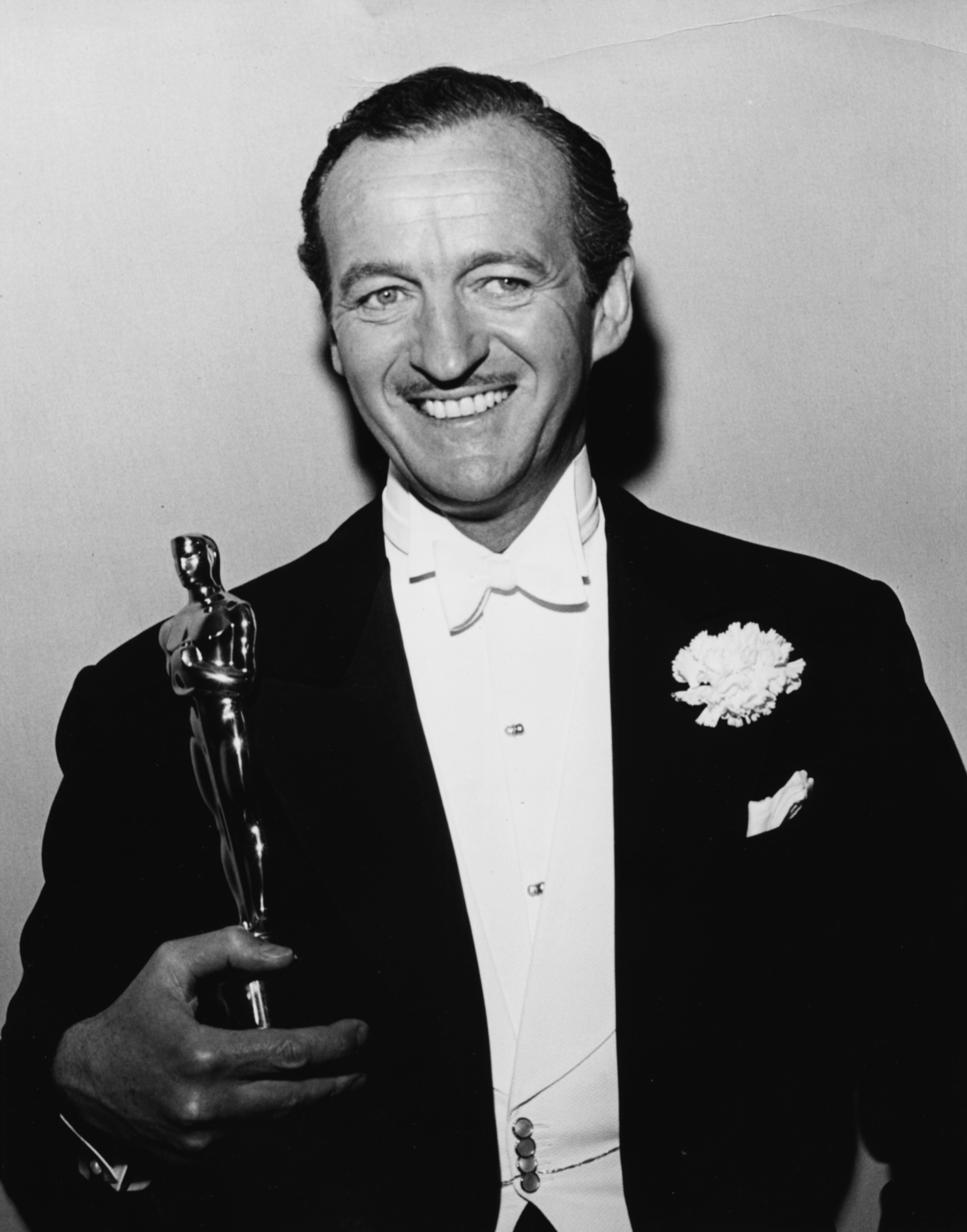 Actor David Niven holding his Best Actor Oscar for the film 'Separate Tables', at the 31st Academy Awards, Los Angeles, April 6th 1959.