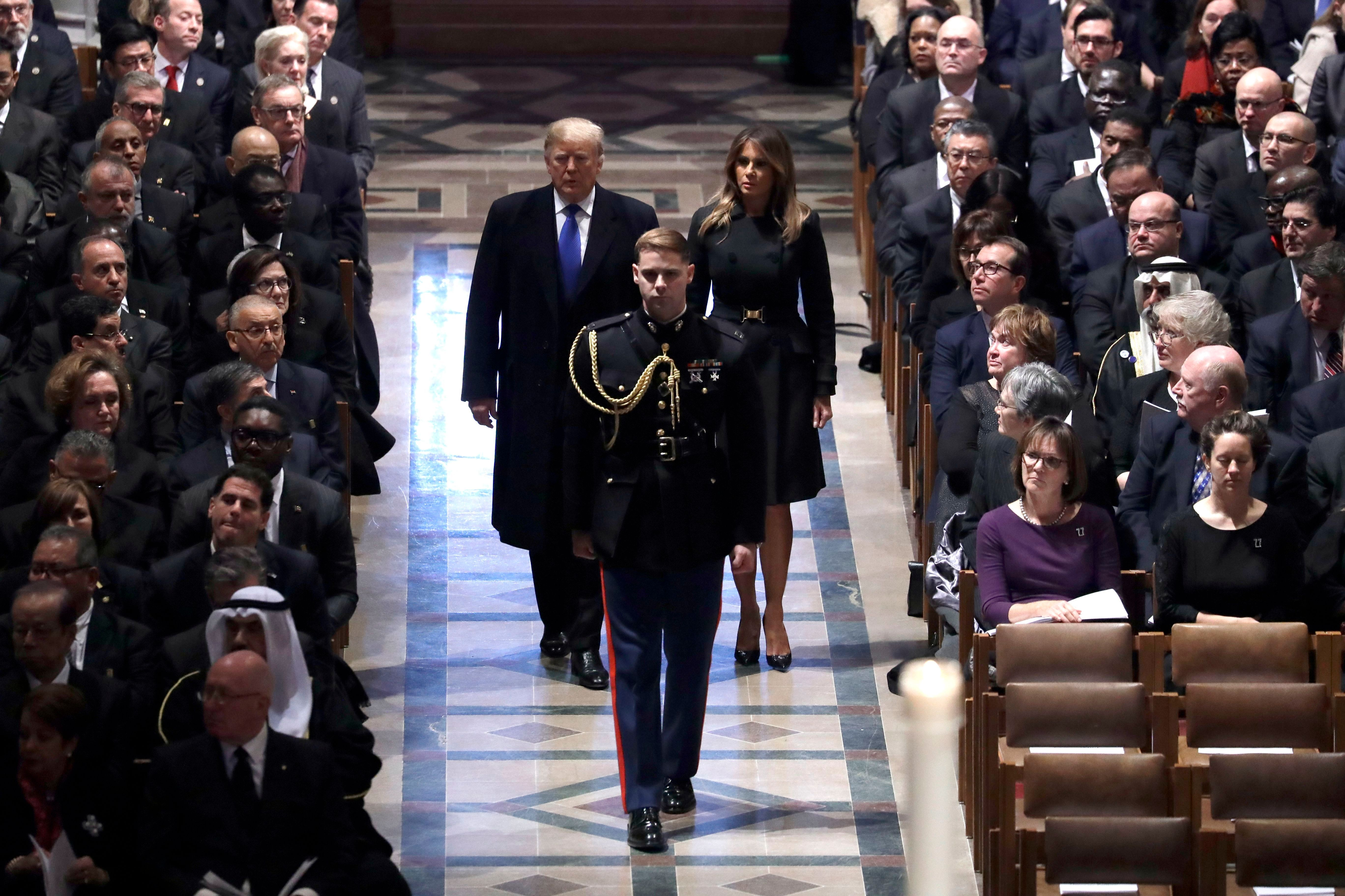 President Donald Trump and first lady Melania Trump arrive for the State Funeral former President George H.W. Bush, at the National Cathedral, in Washington on Dec. 5, 2018.