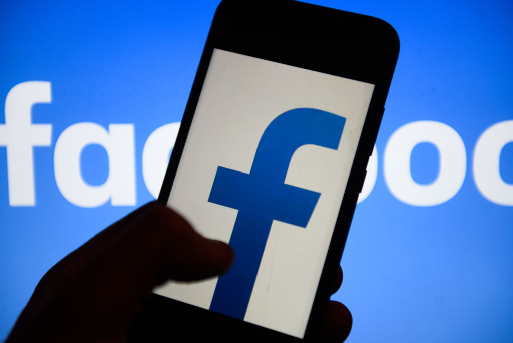 Facebook  logo is seen on an android mobile phone.