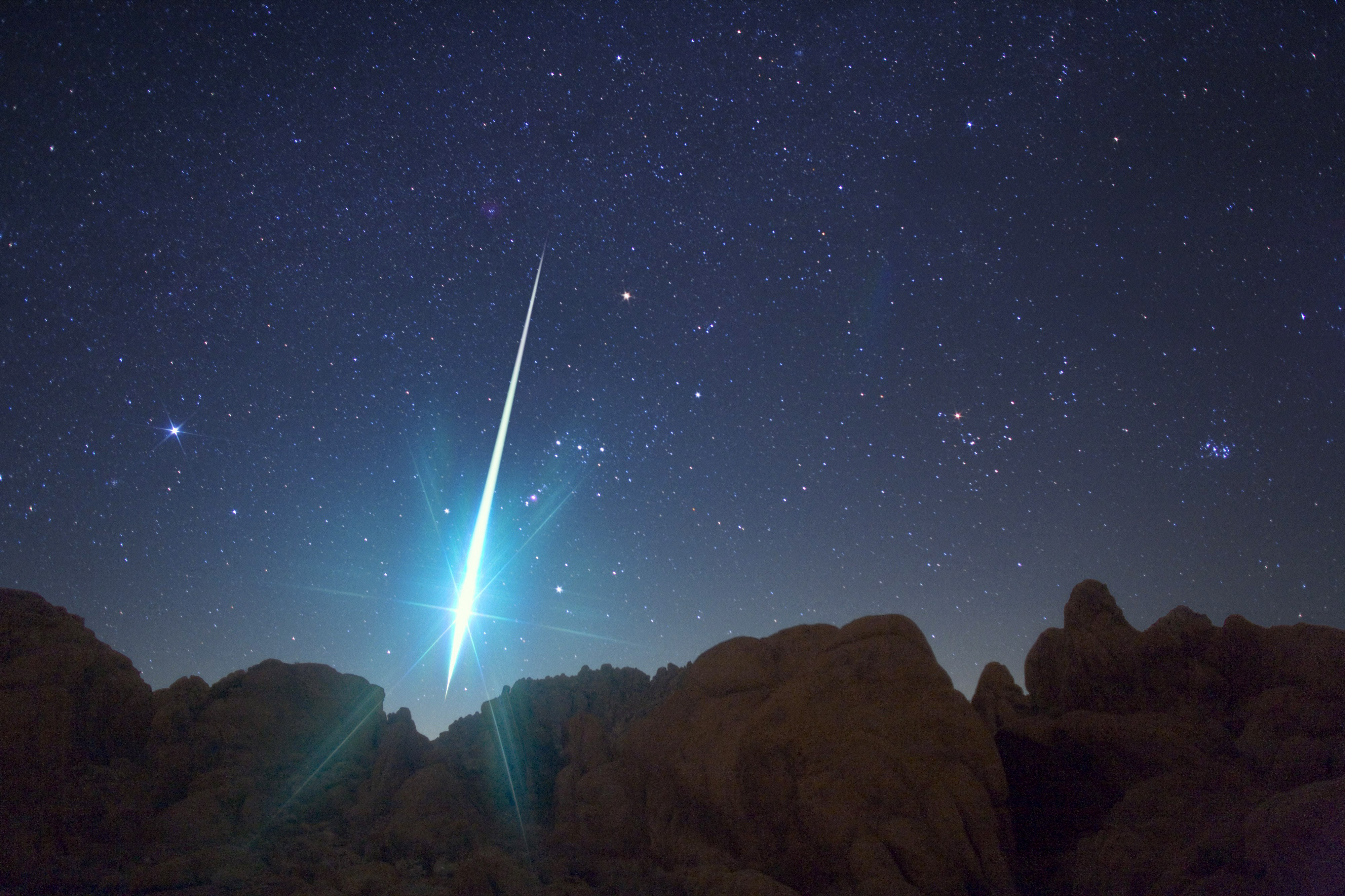 A meteor hurtling to earth during the annual Geminid meteor shower on December 14, 2009.