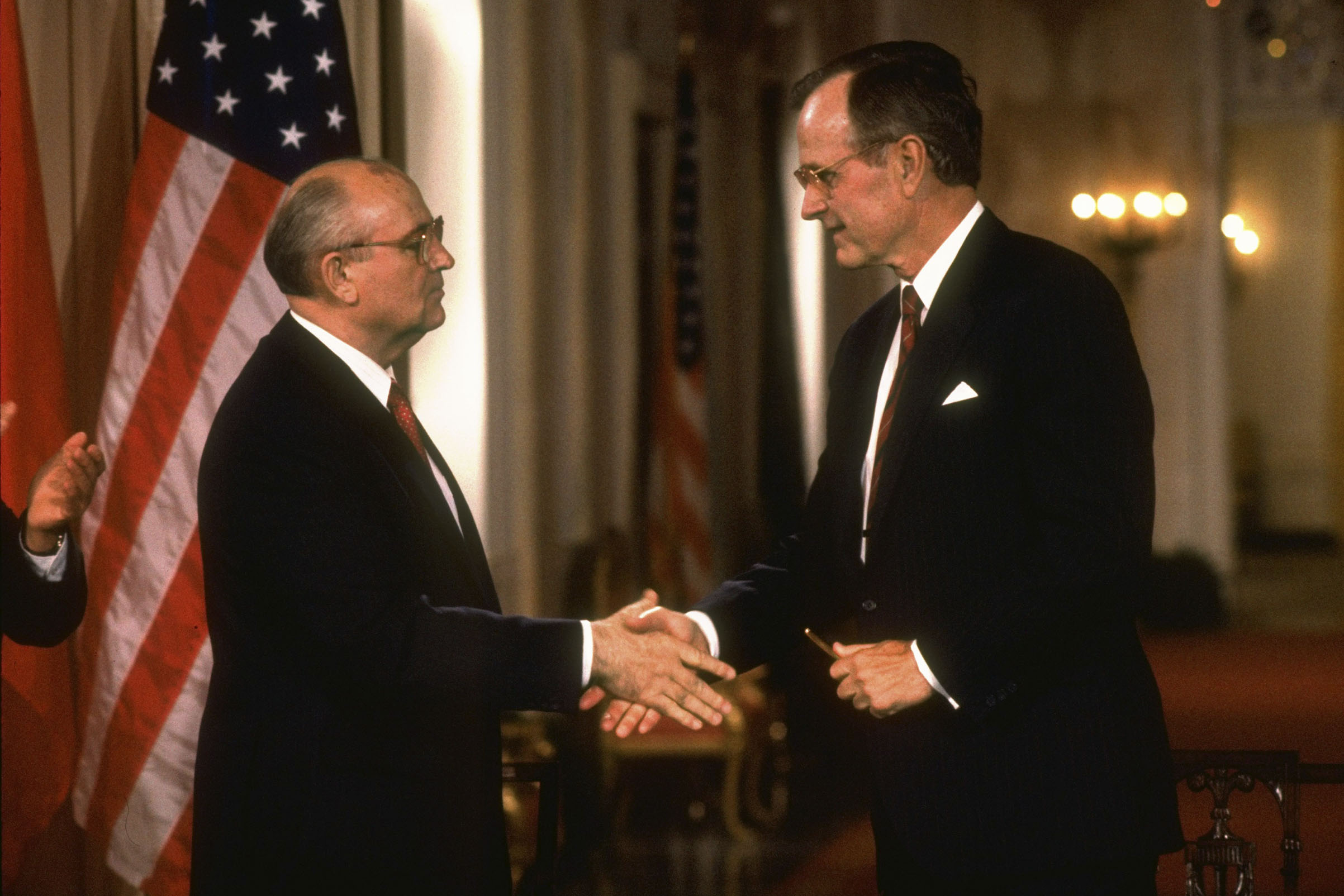 Gorbachev, left, shakes Bush's hand after signing an agreement on June1, 1990