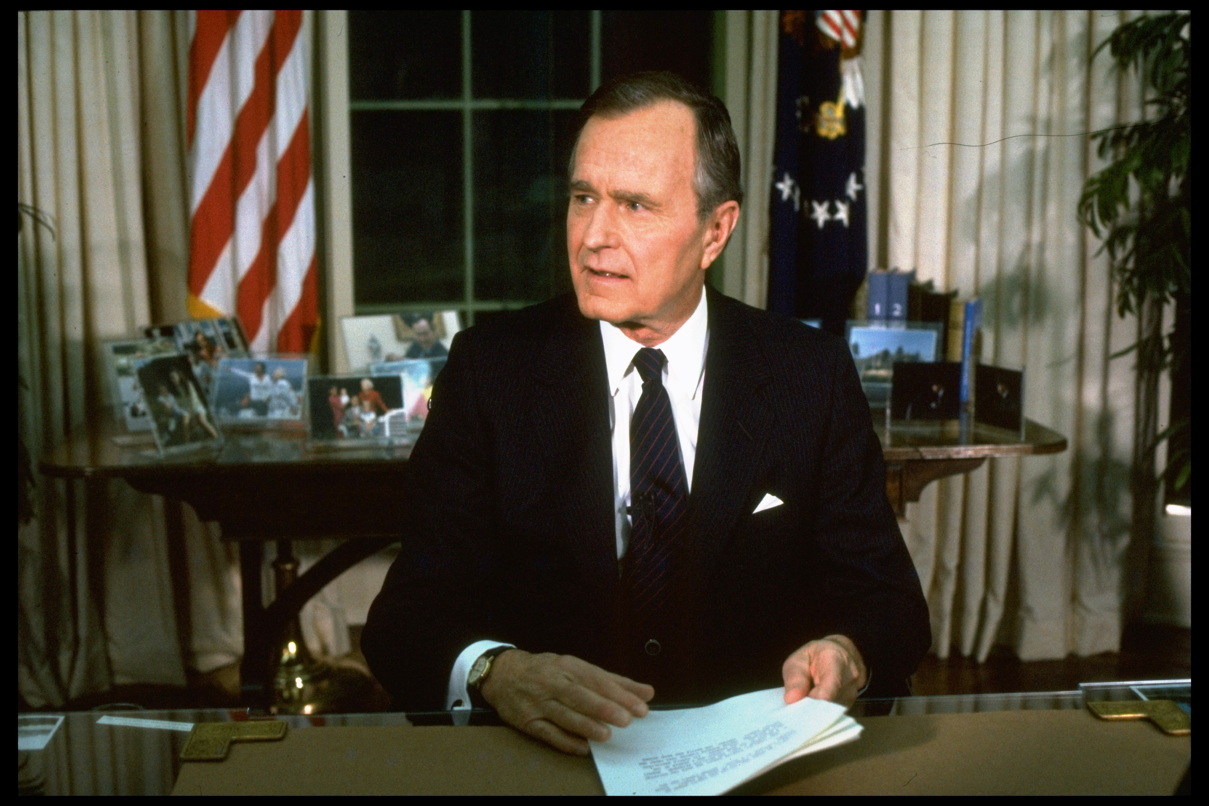 President George H.W. Bush addresses the nation from the Oval Office about the start of Operation Desert Storm.