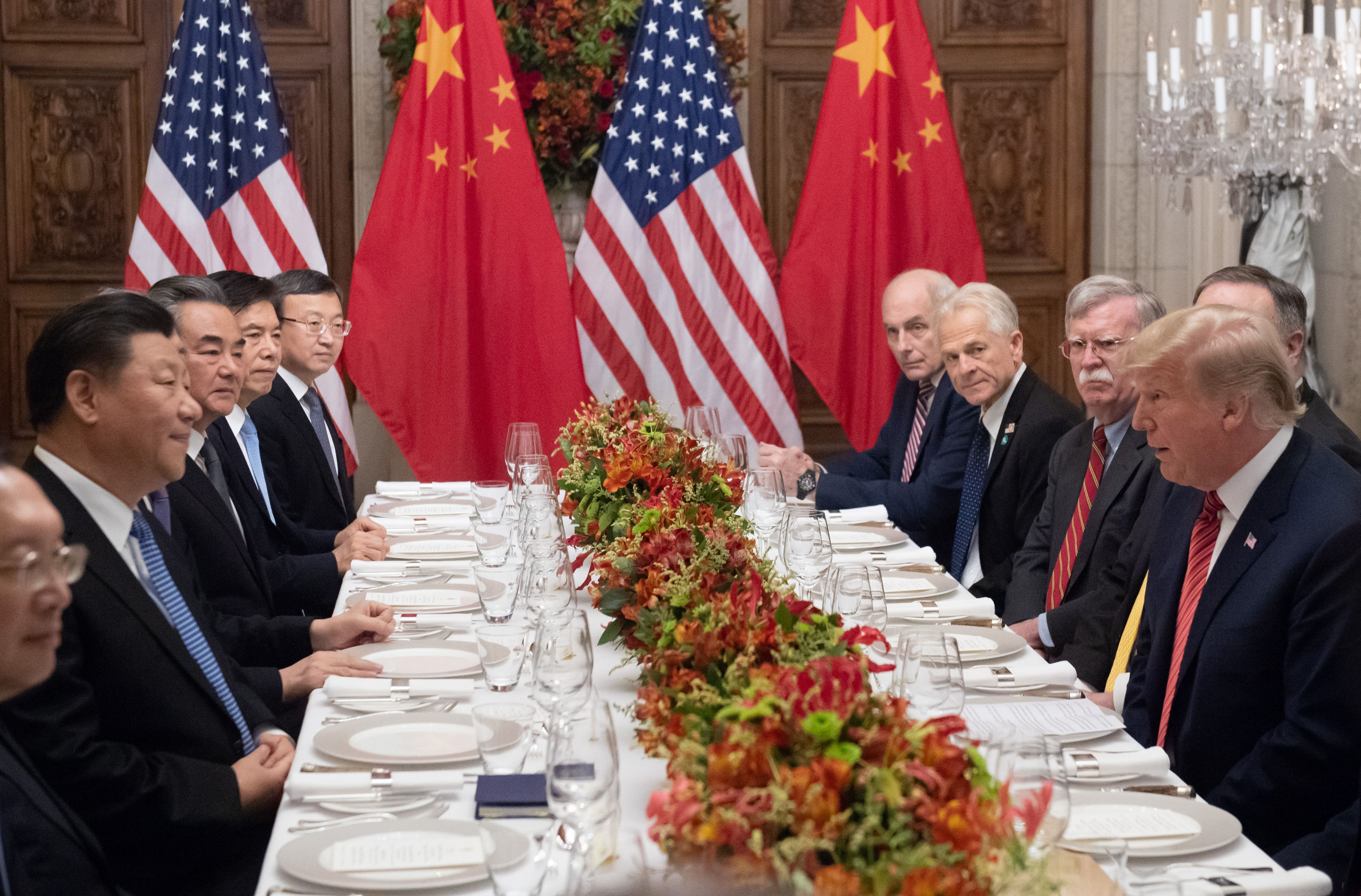 U.S. President Donald Trump (R) and China's President Xi Jinping (L) along with members of their delegations, hold a dinner meeting at the end of the G20 Leaders' Summit in Buenos Aires, on Dec. 1, 2018.
