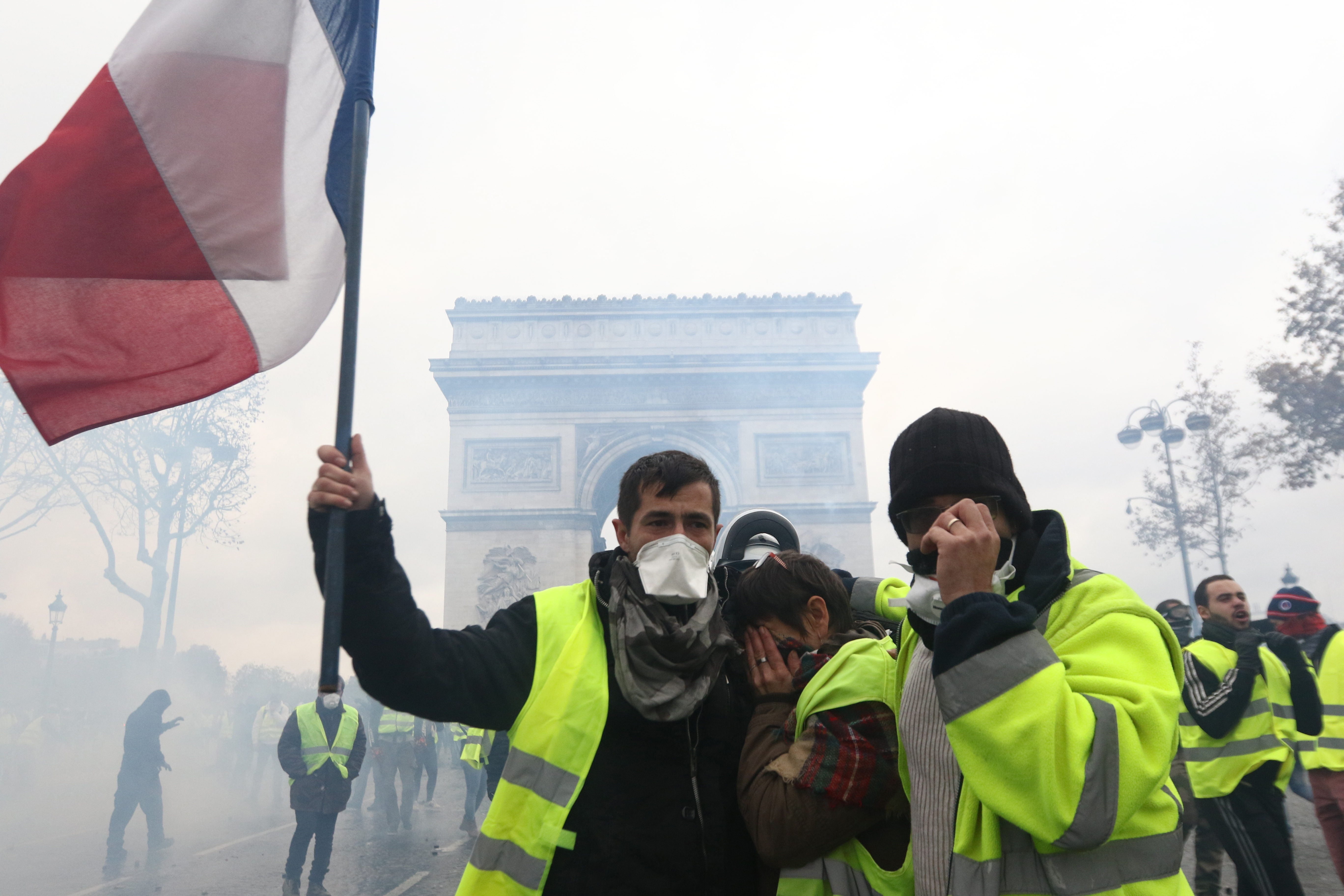 Yellow vest protesters clash with riot police as part of demonstration against rising fuel taxes near Arc de triomphe de l'Etoile in Paris, France on December 01, 2018.