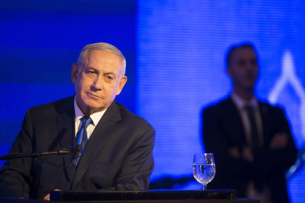 Israeli Prime Minister Benjamin Netanyahu gestures while delivering a speech before lighting a stylised-menorah during the start of Hanukkah, the Jewish festival of lights on Dec. 2, 2018 in Ramat Gan, Israel