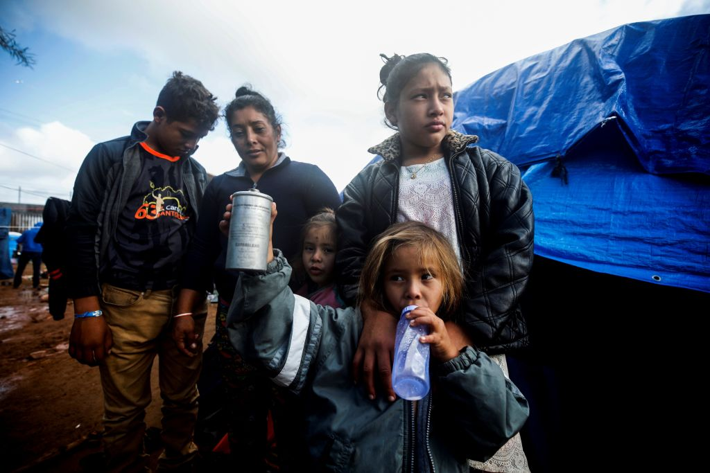 Maria Lila Meza Castro (Rear C), a 39 years old Honduran migrant and a mother of five, stands beside her children as migrants continue to wait for U.S. border gates to open in Tijuana, Mexico on Nov. 30, 2018