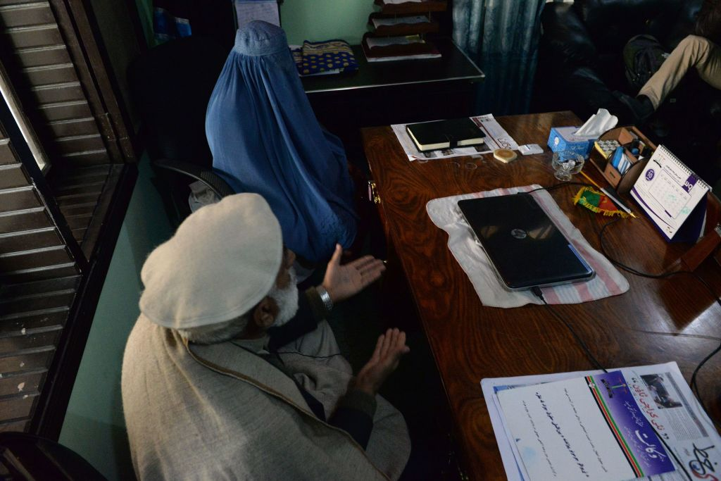 Nadia, 22, an Afghan woman who is trying to get divorced from her husband, sits with her father during an interview with an AFP journalist at her lawyer's office in Jalalabad on Jan. 16, 2017. When Nadia's heroin addict husband began assaulting her with a metal rod, she did something unthinkable for many women in Afghanistan -- she left him. Domestic abuse is endemic in Afghanistan, but a growing number of Afghan women are embracing divorce as a new kind of empowerment.