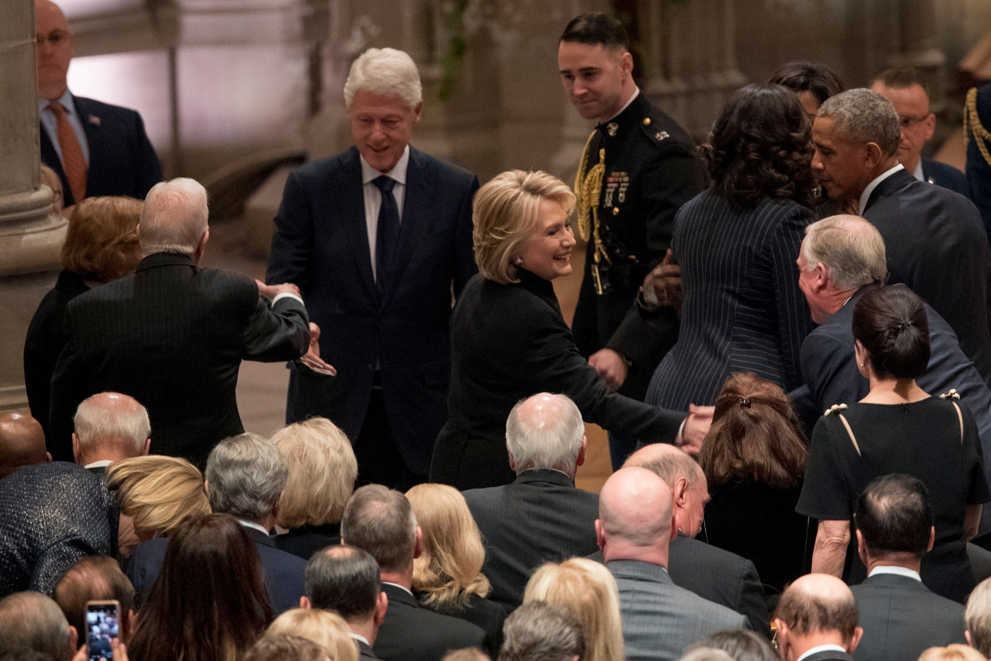 Former President Jimmy Carter, and former first lady Rosalynn Carter, greet former President Bill Clinton, as his wife, former Secretary of State Hillary Clinton, greets a guest before a State Funeral for former President George H.W. Bush at the National Cathedral, in Washington, DC on Dec. 5, 2018.